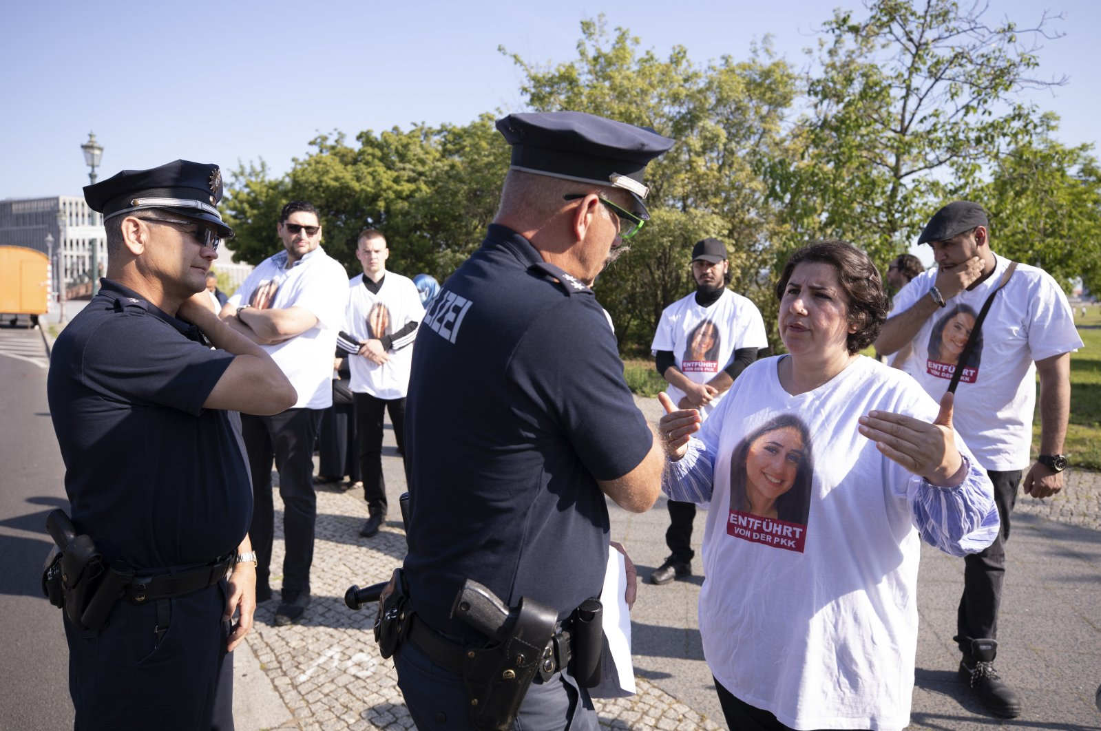 Turkish-German mother Maide T. speaks to police officers during a demonstration in front of the German Chancellory in Berlin, June 17, 2020 (AA Photo)