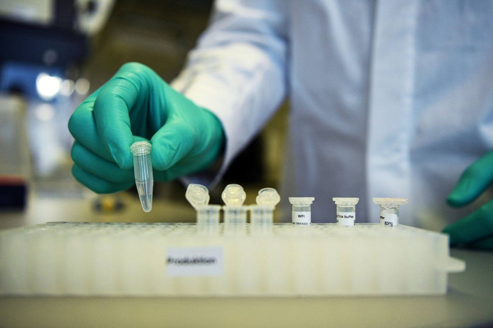 An employee of the German biopharmaceutical company CureVac, demonstrates research workflow on a vaccine for the coronavirus (COVID-19) disease at a laboratory in Tuebingen, Germany, March 12, 2020. (Reuters Photo)