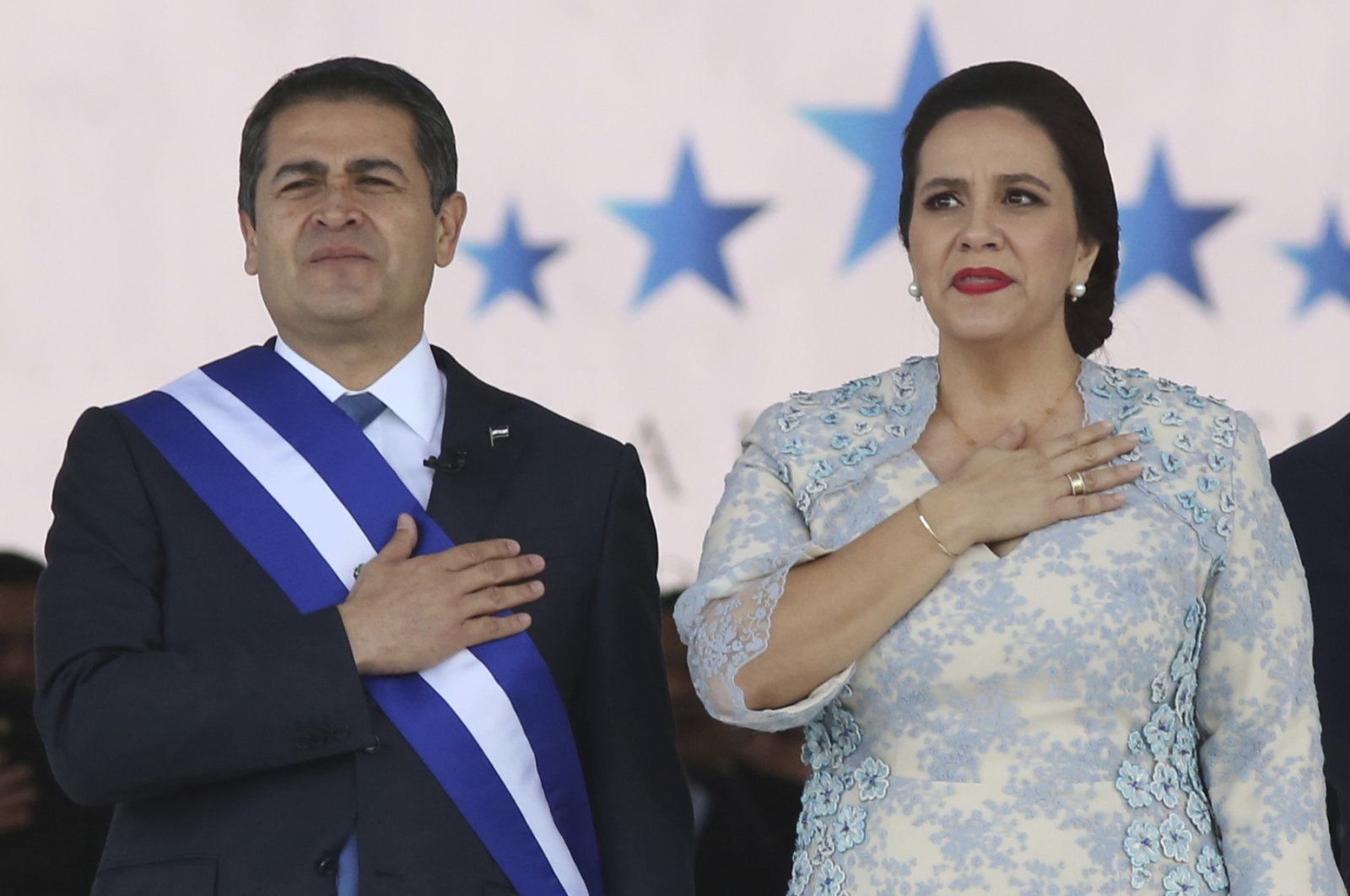 Honduran President Juan Orlando Hernandez stands with his wife Ana Garcia during the presidential inauguration ceremony for his second term at the National Stadium, Tegucigalpa, Jan. 27, 2018. (AP Photo)
