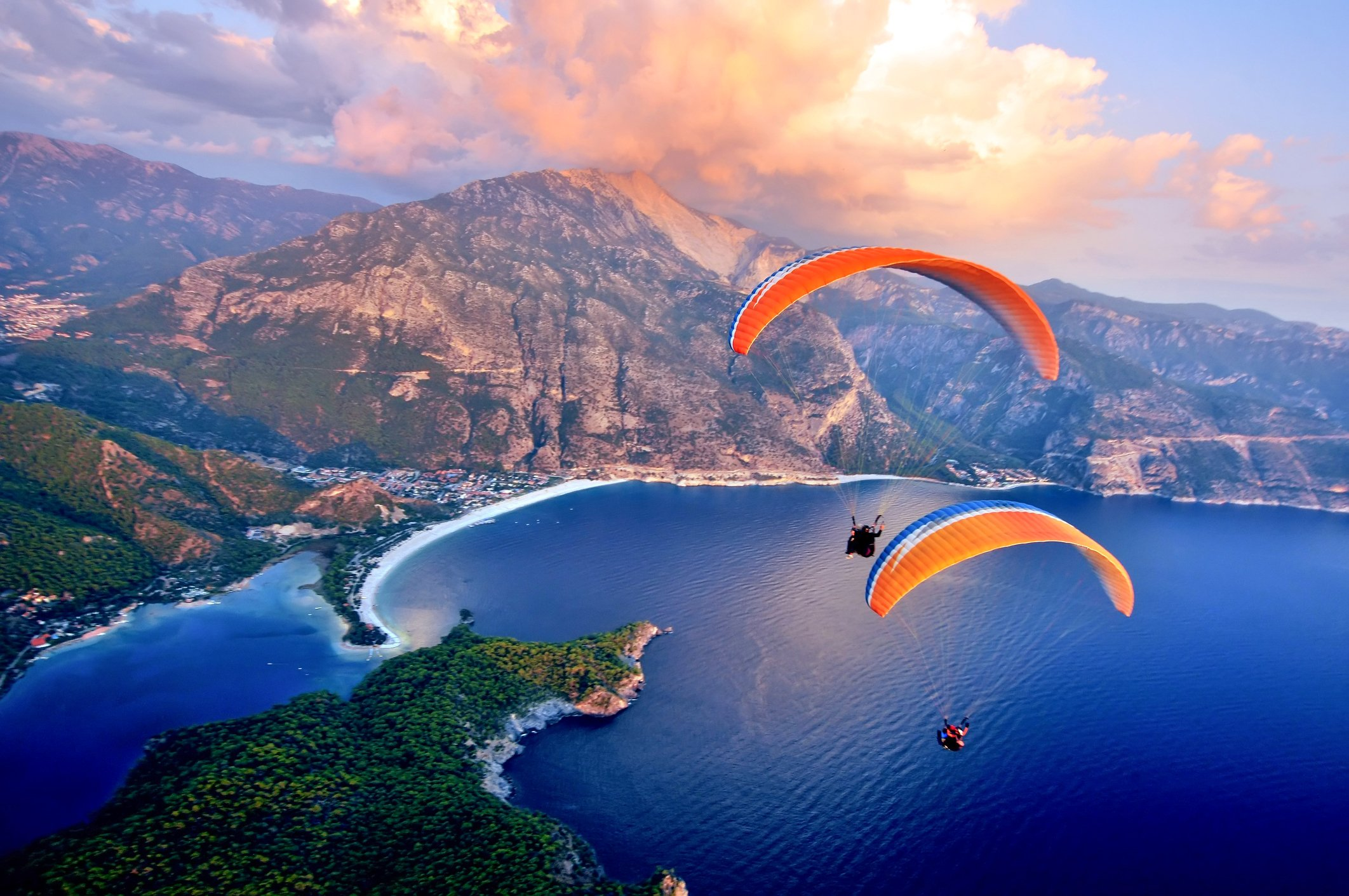 Paragliding into the sunset over Ölüdeniz in Fethiye should be on every adventurer's bucket list. (Kenan Olgun / iStock)