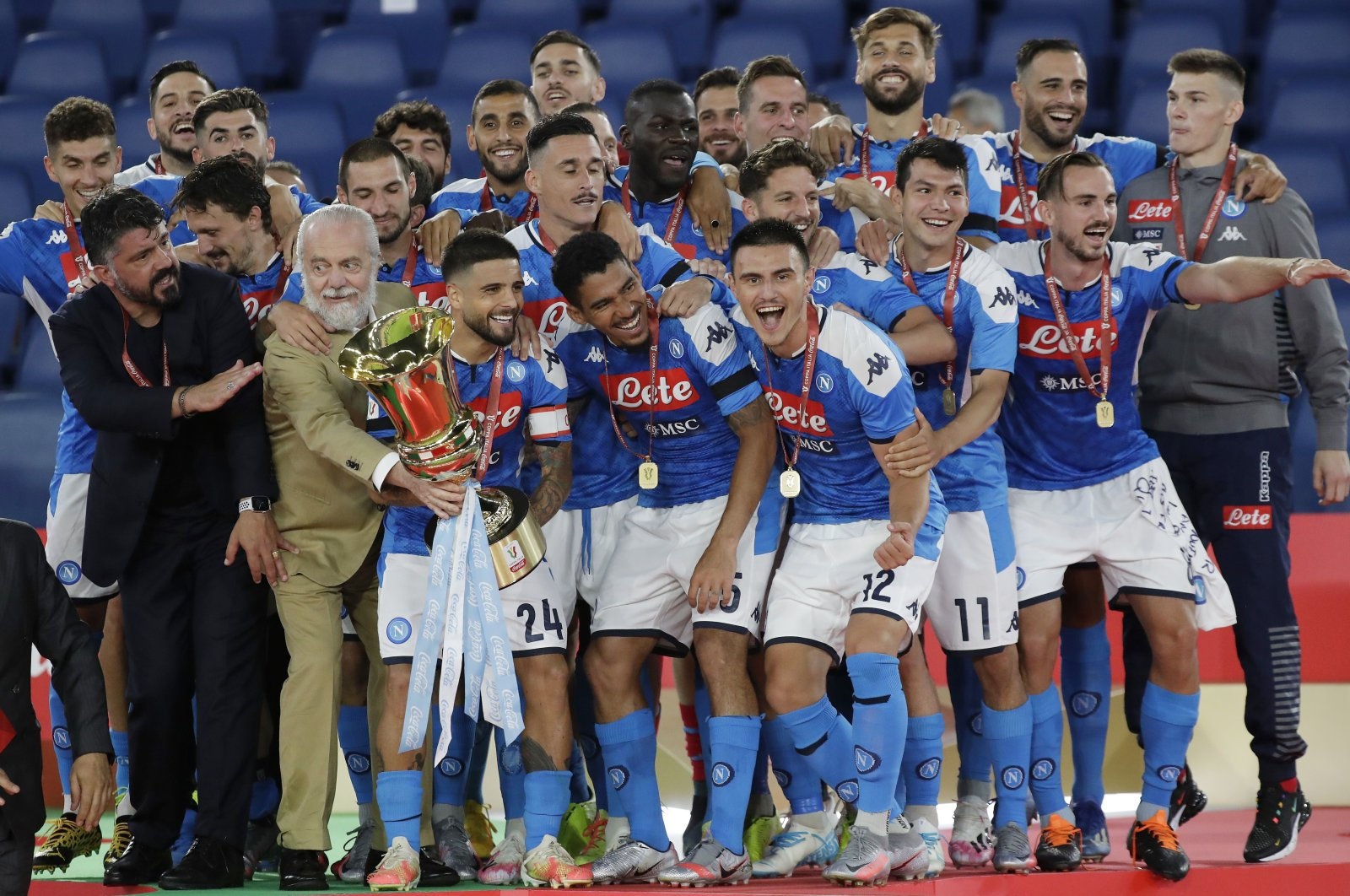 Napoli's Lorenzo Insigne holds up the Italian Cup trophy at the end of the final match between Napoli and Juventus, at Rome's Olympic stadium, Italy, June 17, 2020. (AP Photo)