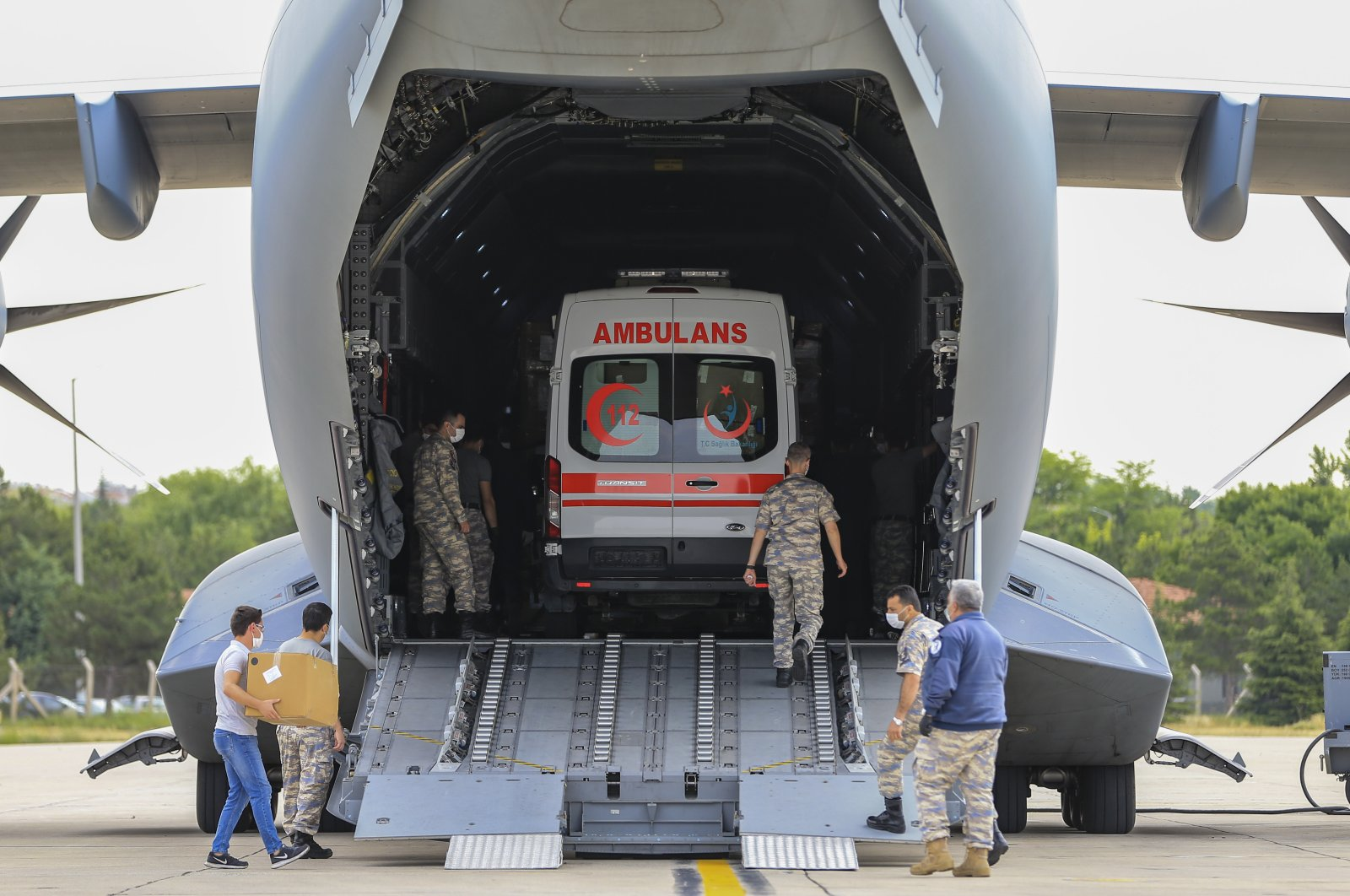 A Turkish Armed Forces (TSK) aircraft carrying a second batch of medical supplies and an ambulance prepares to depart Ankara for Chad to aid in the fight against COVID-19, June 18, 2020. (AA Photo)