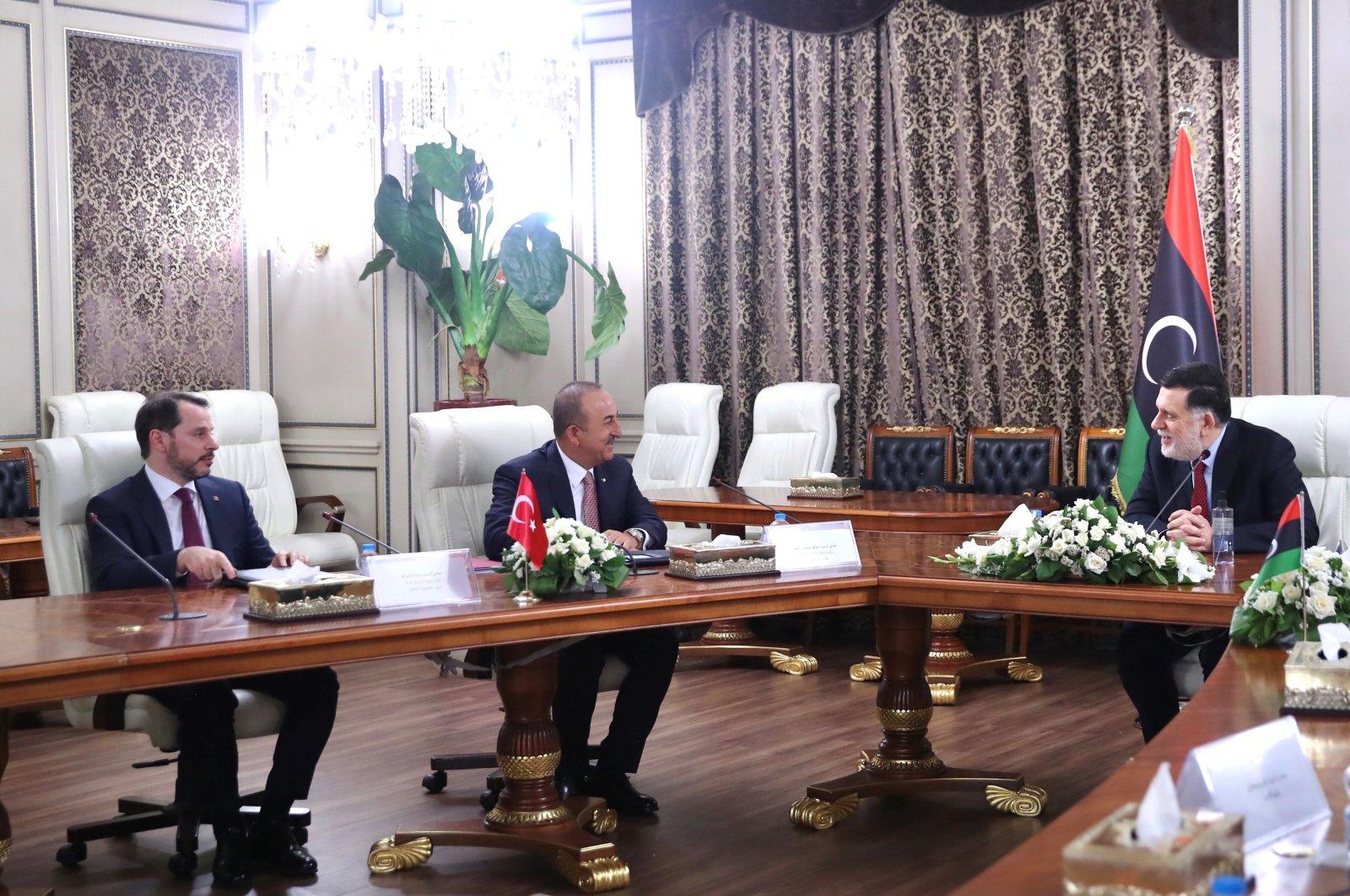 Libya's internationally recognized Prime Minister Fayez Sarraj is seen with Turkey's Foreign Minister Mevlüt Çavuşoğlu and Finance Minister Berat Albayrak during their meeting in Tripoli, Libya, June 17, 2020. (AFP Photo)