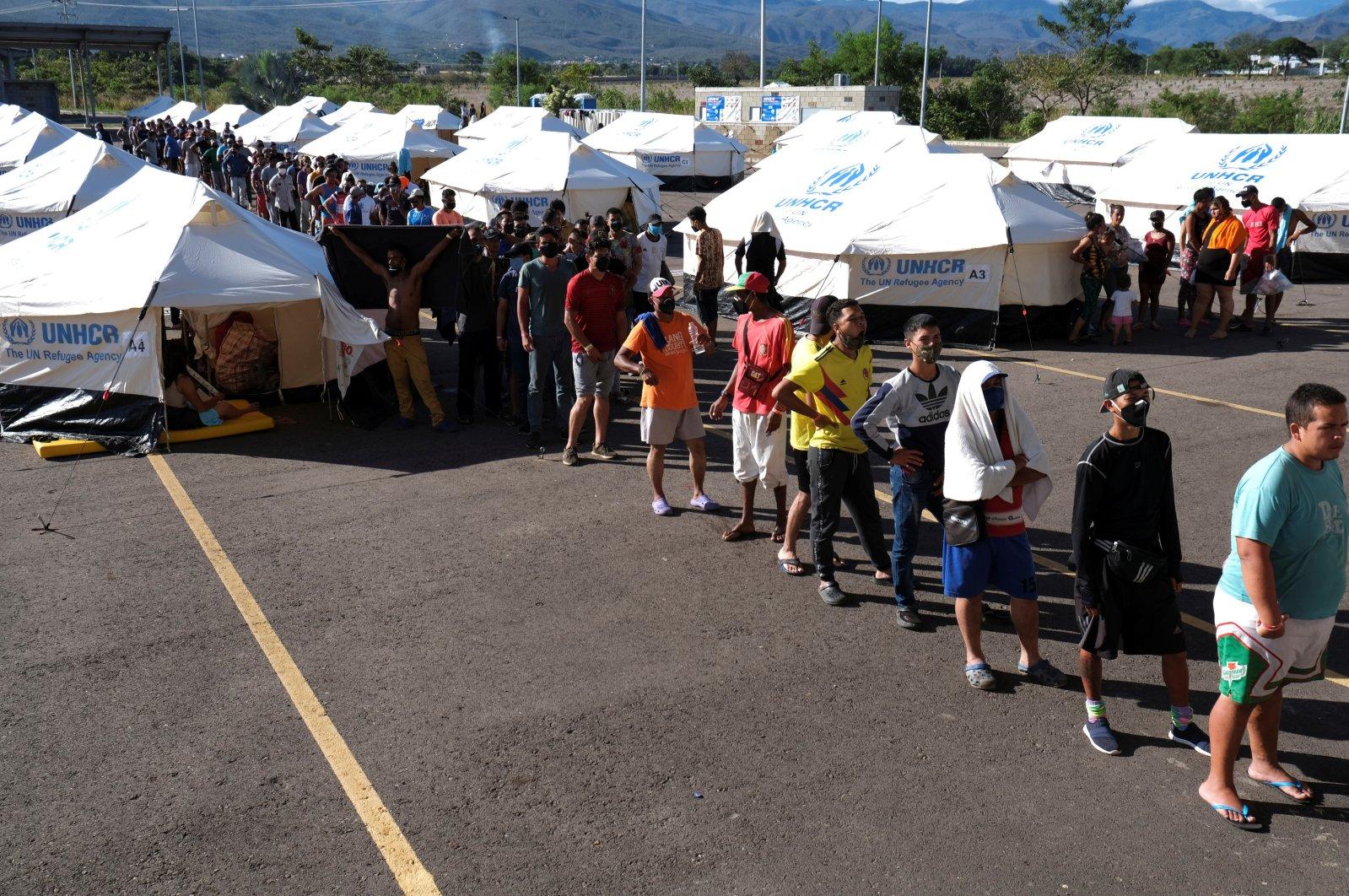 Venezuelan migrants stand in line at a health care center at the Venezuelan border, Cucuta, Colombia, June 16, 2020. (Reuters Photo)