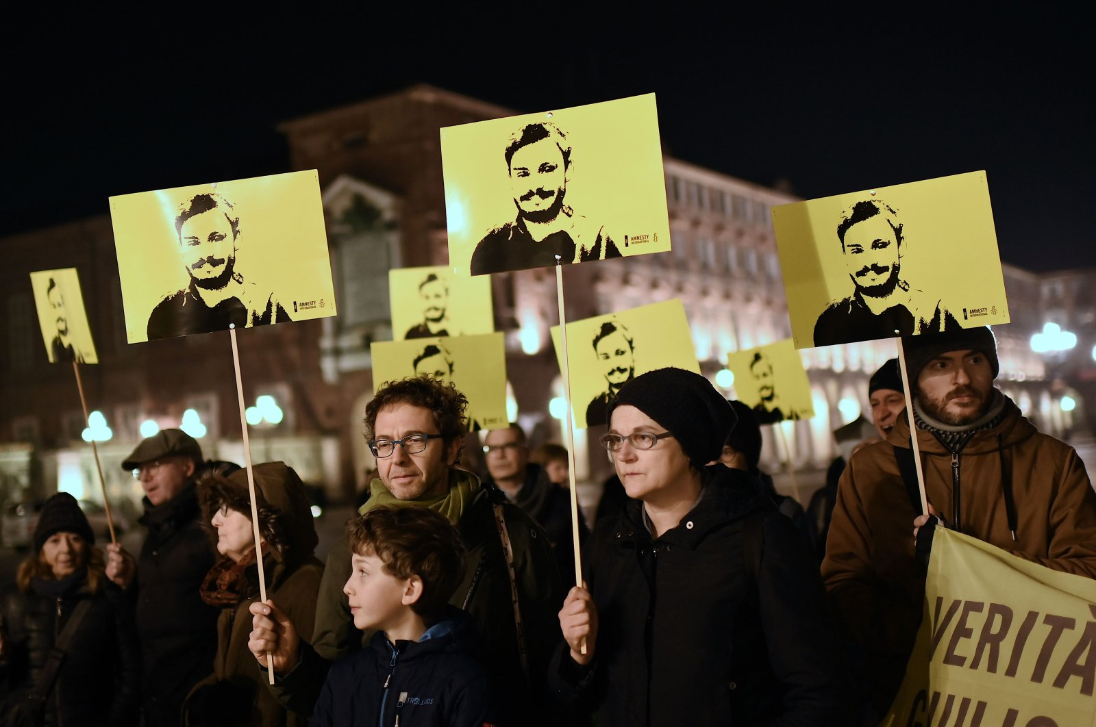 Activists of human rights organization Amnesty International take part in a demonstration in Piazza Castello in Turin to mark the fourth anniversary since the disappearance of Italian student Giulio Regeni, Jan. 25, 2020. (AFP Photo)