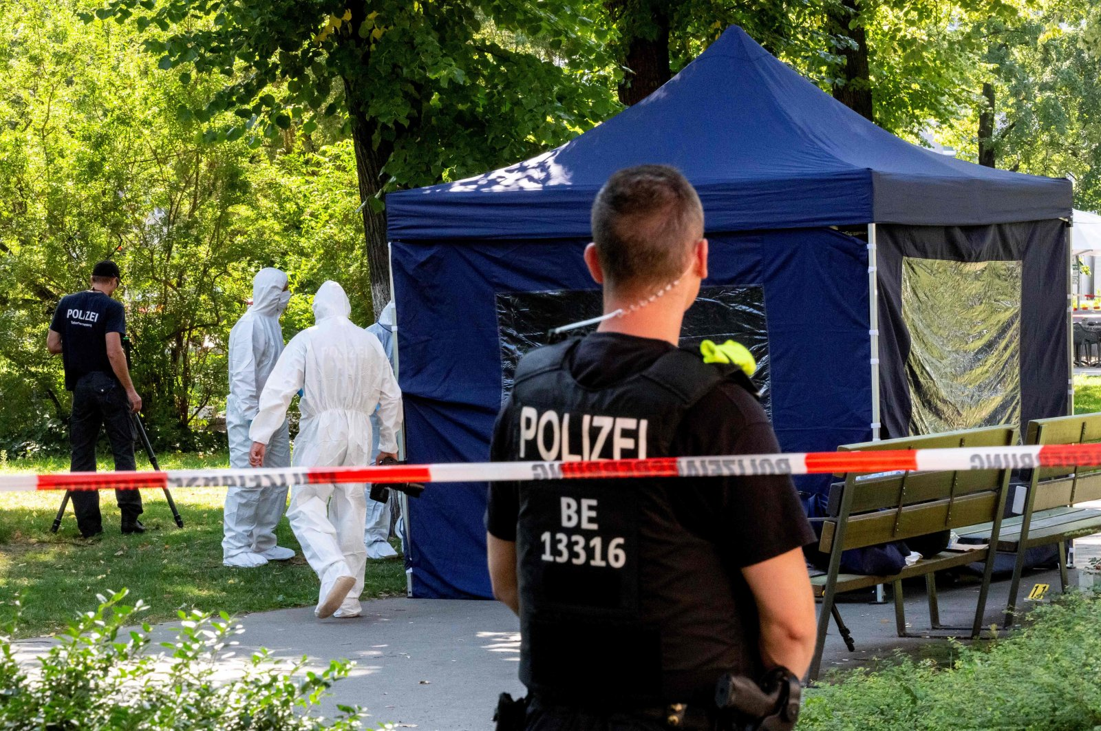 Forensic experts of the police secure evidence at the site of a crime scene in a park of Berlin's Moabit district, where a man of Georgian origin was shot dead, Germany, Aug. 23, 2019. (AFP Photo)