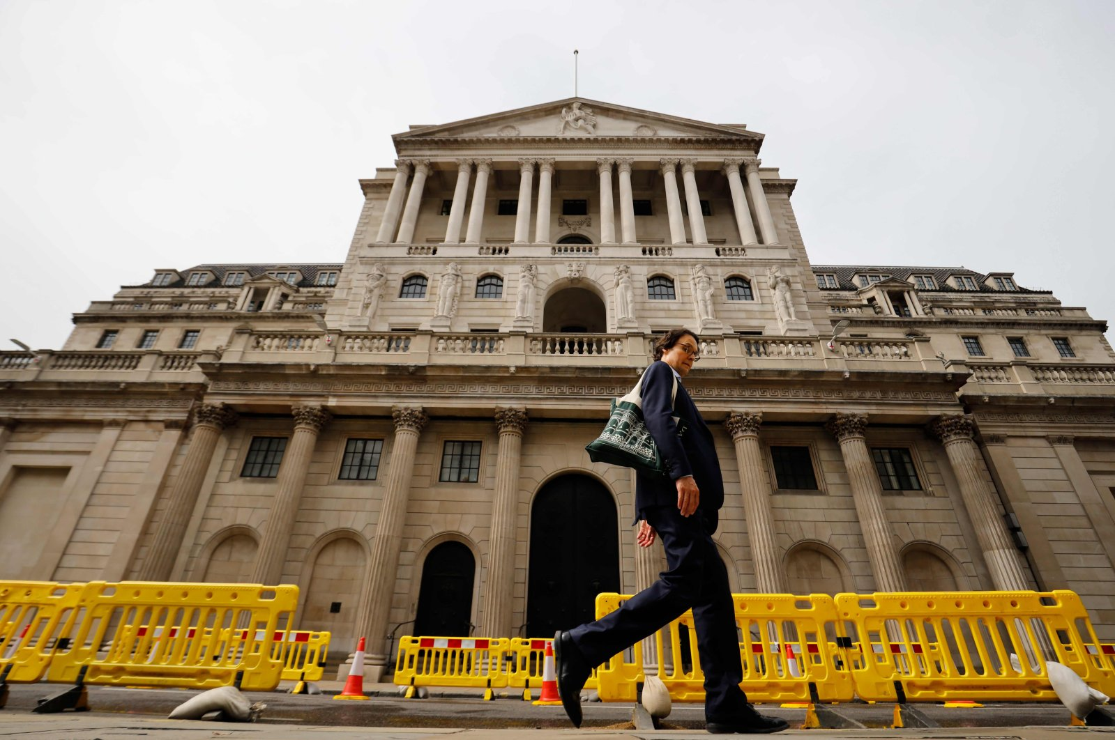 A pedestrian walks past the Bank of England in London during the coronavirus outbreak, June 17, 2020. (AFP Photo)