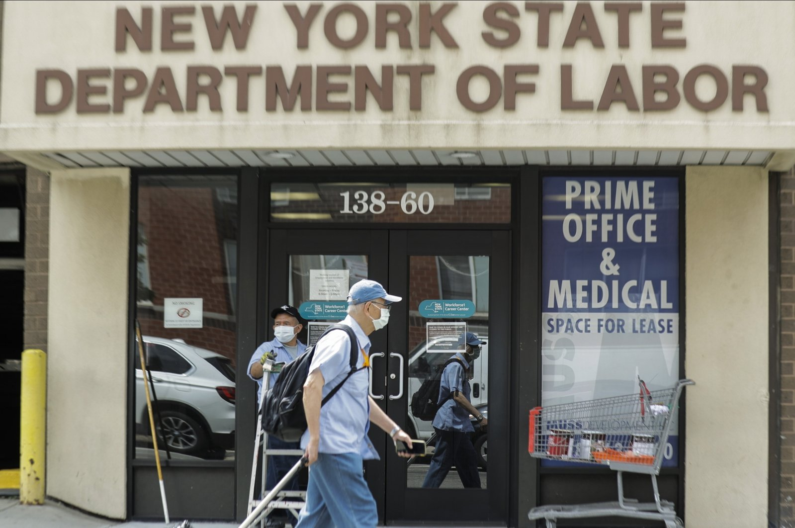 Pedestrians pass an office location for the New York State Department of Labor in the Queens borough of New York City, New York, US., June 11, 2020. (AP Photo)