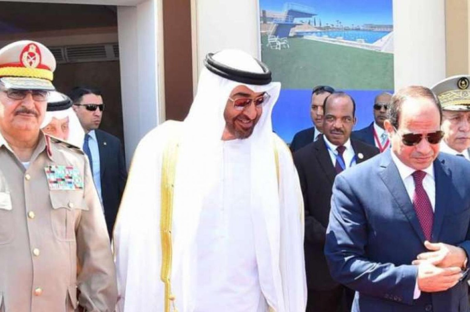 In this July 22, 2017, file photo, Egyptian President Abdel-Fattah el-Sissi (R), Crown Prince of Abu Dhabi Mohammed bin Zayed (C) and Libyan warlord Khalifa Haftar (L) attend the opening of the Mohamed Najib Military Base, El Hammam, Marsa Matrouh, Egypt. (The Egyptian Presidency / Reuters)