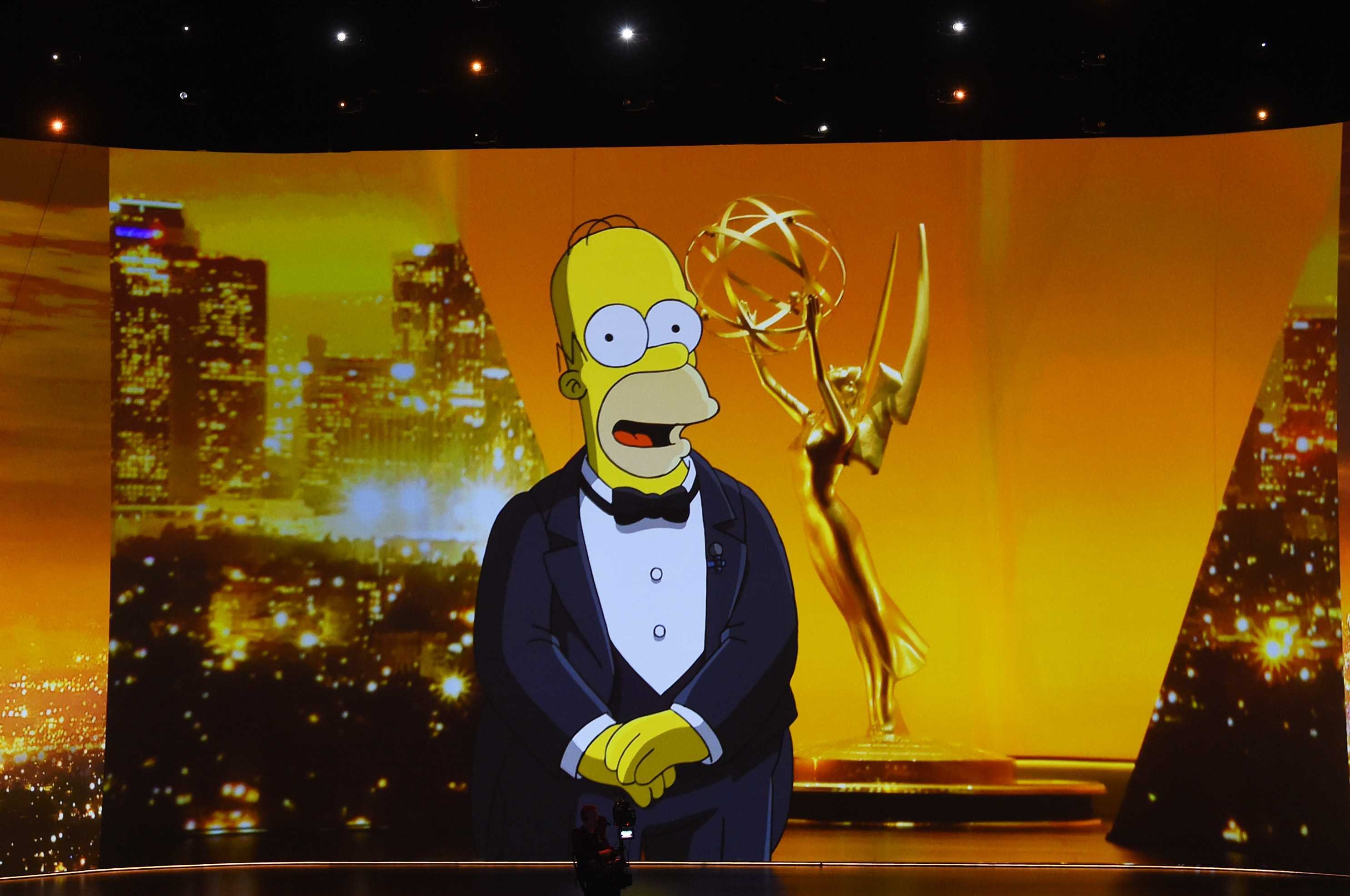 A video of Homer Simpson speaking is projected on a screen during the 71st Emmy Awards at Microsoft Theater in Los Angeles, California, U.S., Sept. 22, 2019. (Getty Images)