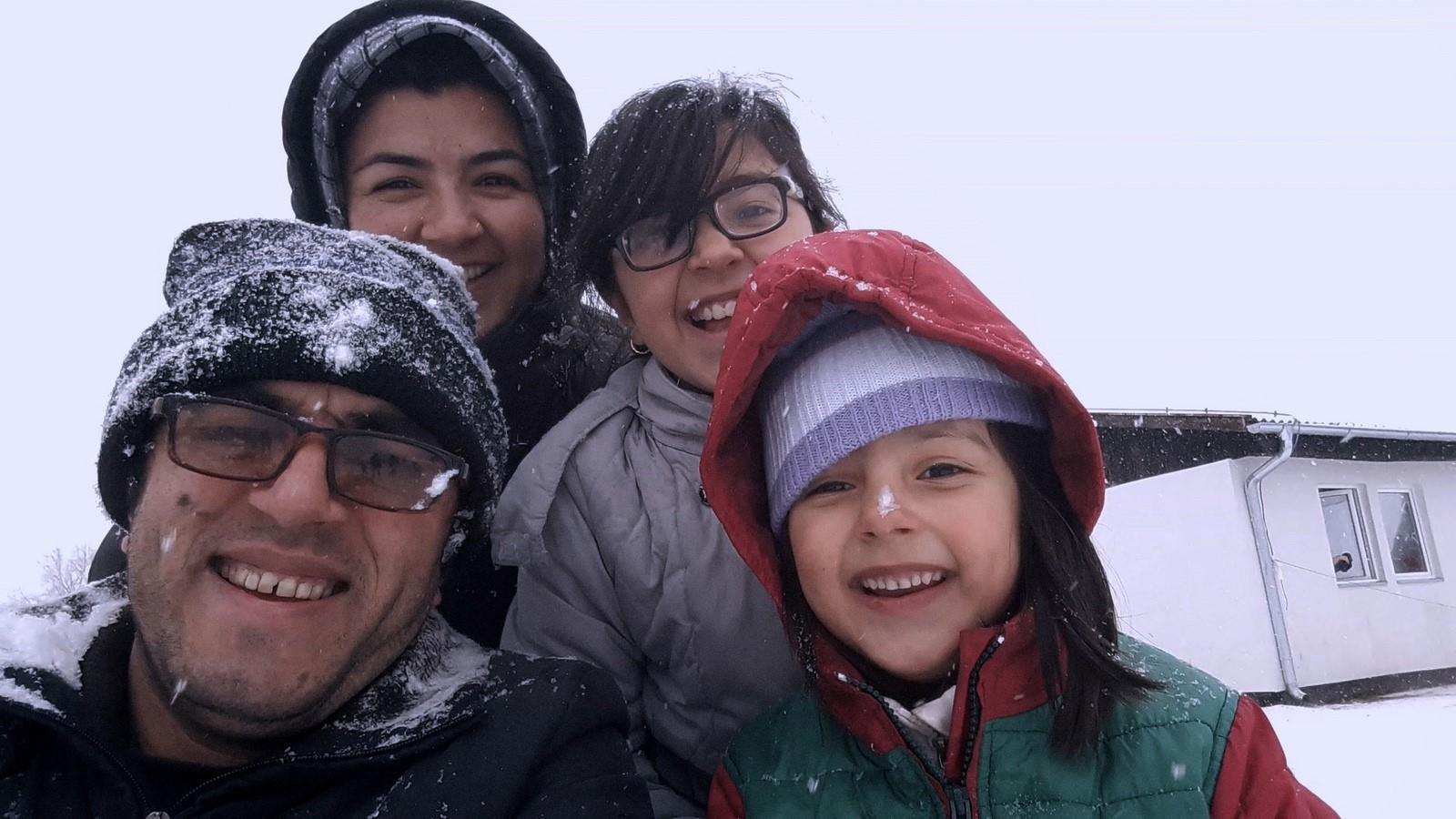 Hassan Fazili (front L), Zahra Fazili (front R), Fatima Hussaini (back L) and Nargis Fazili (back R) pose together.
