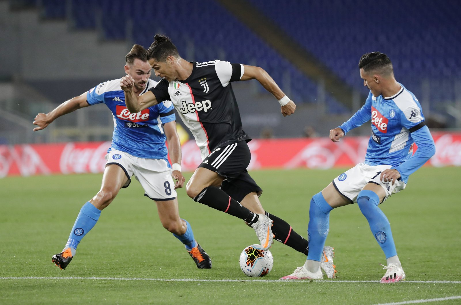 Juventus' Cristiano Ronaldo tries to dribble past Napoli players during the Italian Cup final match in Rome, Italy, June 17, 2020. (AP Photo)