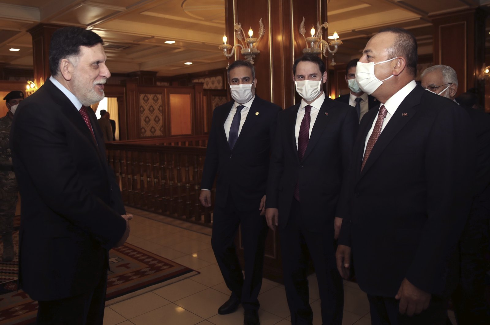 Turkish Foreign Minister Mevlüt Çavuşoğlu and Libyan Prime Minister Fayez Sarraj greet each other before their talks in Tripoli, Libya, June 17, 2020. (AP Photo)
