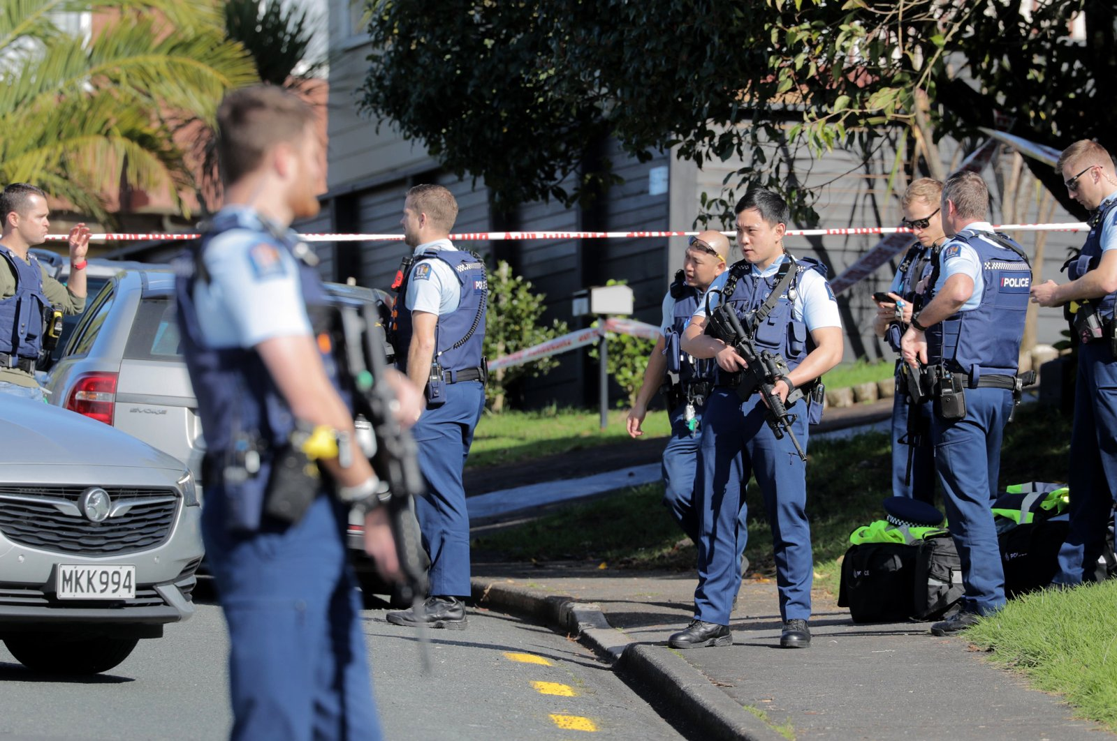 Armed police gather at the scene of a shooting incident following a routine traffic stop, Auckland, New Zealand, June 19, 2020. (AP Photo)