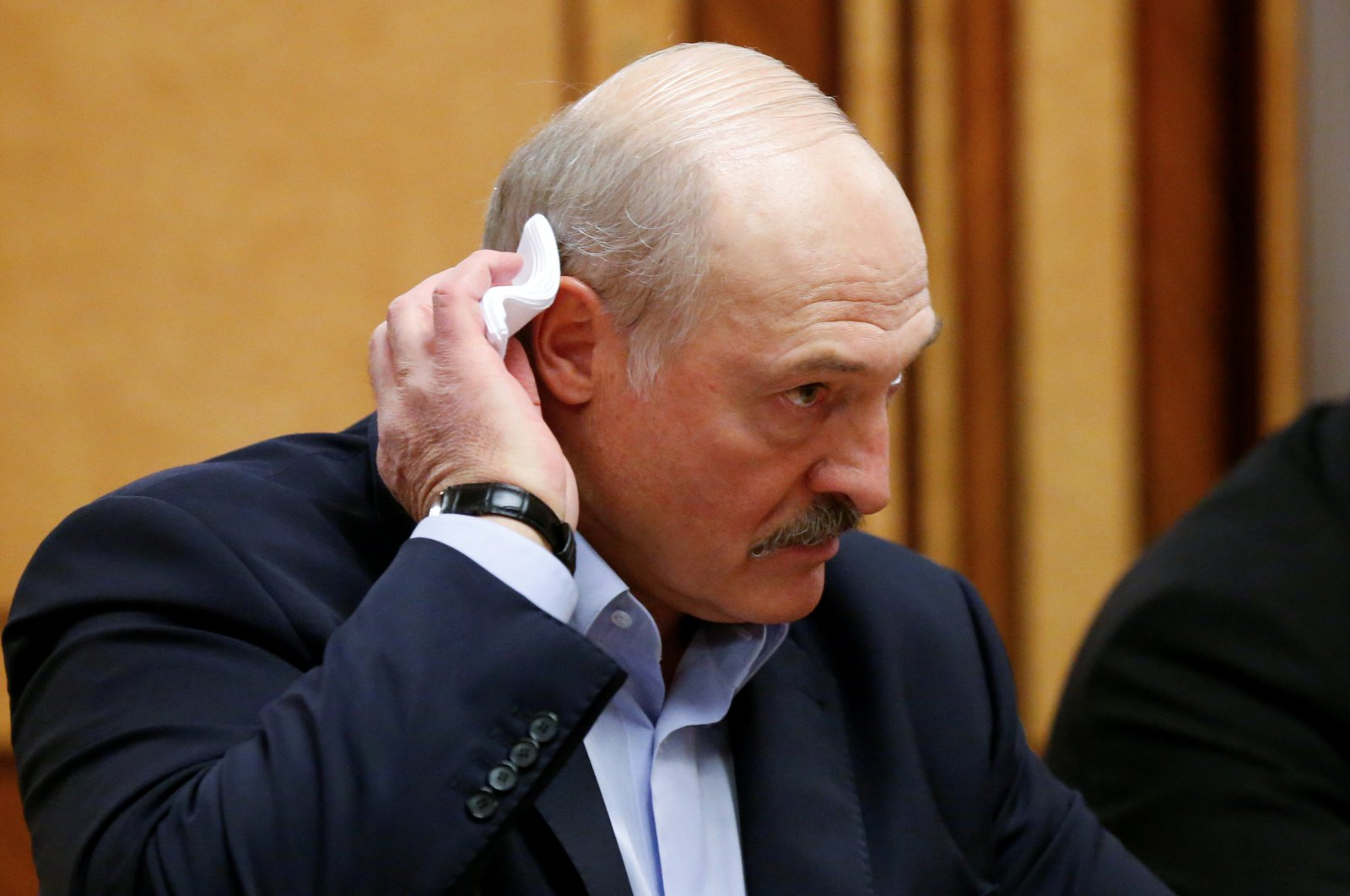 Belarusian President Alexander Lukashenko listens to Russian President Vladimir Putin, not pictured, during their meeting in the Black Sea resort of Sochi, Russia, Feb. 7, 2020. (Reuters Photo)