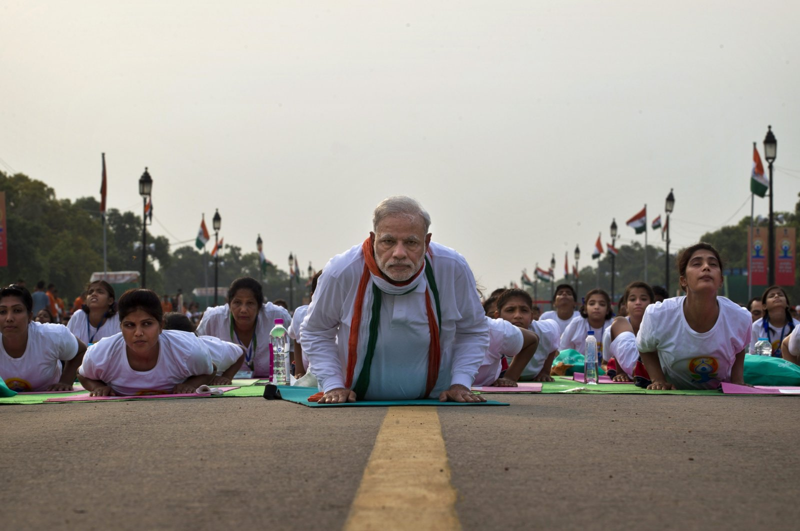 Indian Prime Minister Narednra Modi lies down on a mat as he performs yoga along with thousands of Indians on Rajpath, in New Delhi, India, June 21, 2015. (AP Photo)
