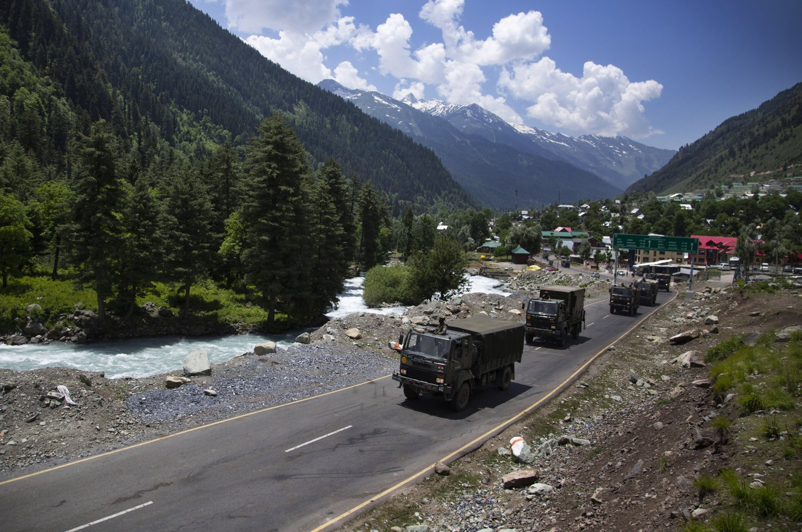 An Indian army convoy moves on the Srinagar- Ladakh highway at Gagangeer, northeast of Srinagar, India, Wednesday, June 17, 2020. (AP Photo)