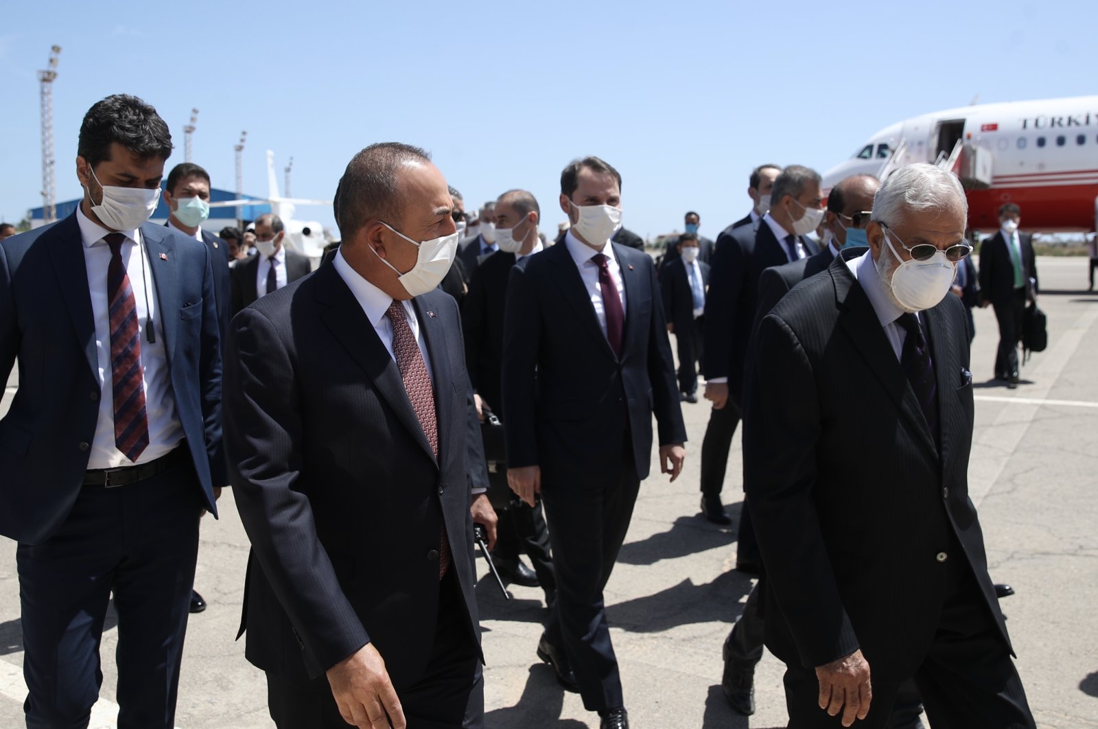 Turkey's Foreign Minister Mevlut Çavuşoğlu, left and Mohamed Taher Siala, Foreign Minister of Libya's internationally-recognized government, speak at the airport, in Tripoli, Libya, June 17, 2020. (Turkish Foreign Ministry via AA)