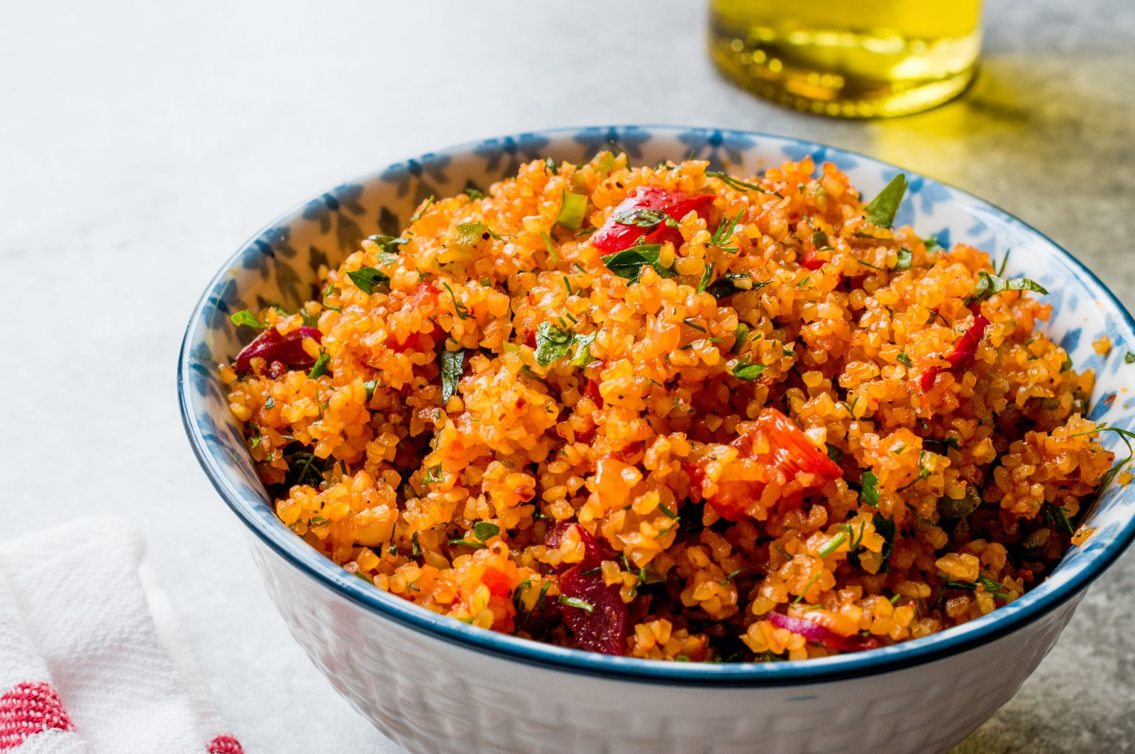 The more tomato paste you use in your kısır mix, the redder it will look. (Shutterstock Photo)