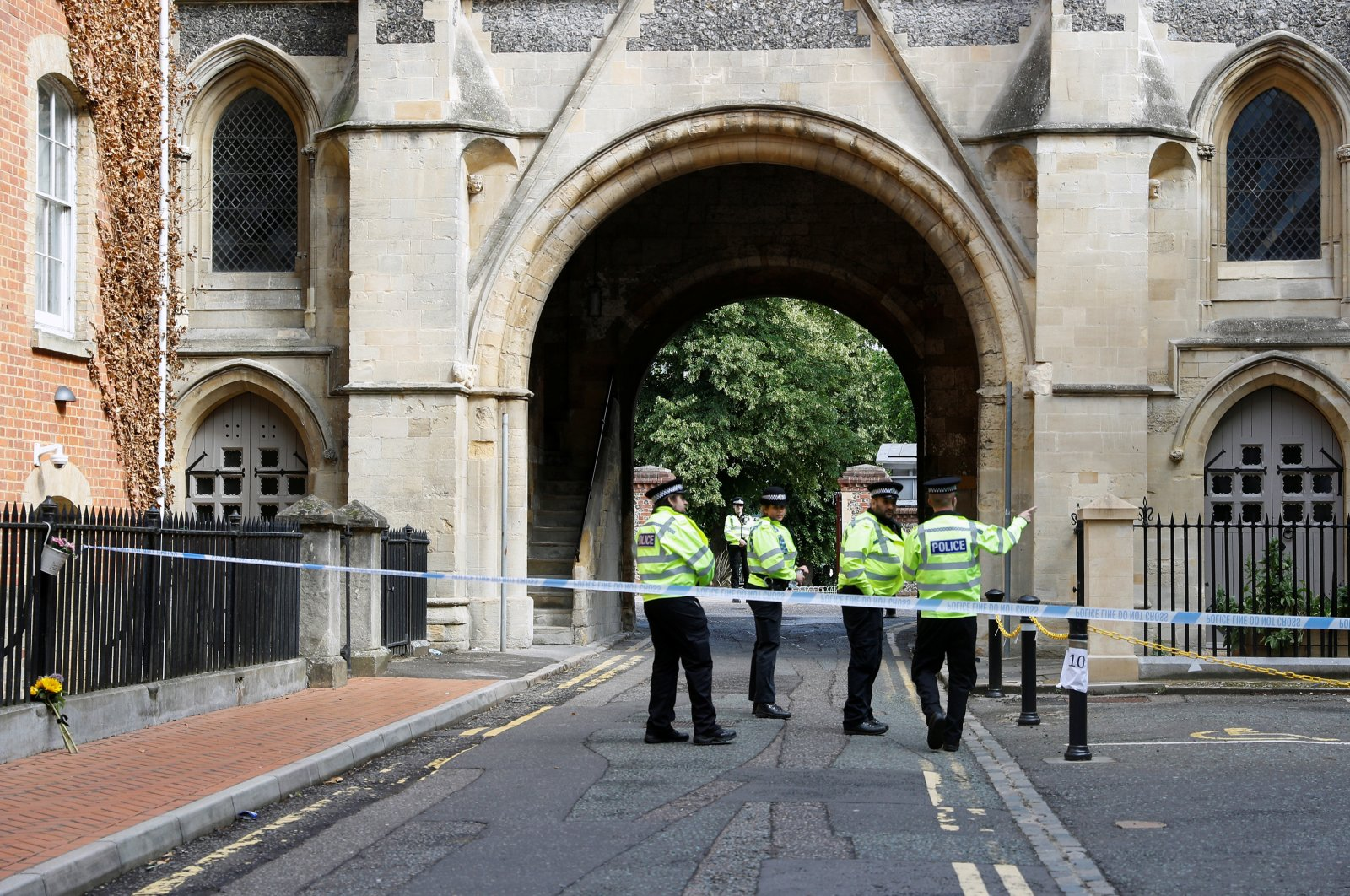 Police officers stand behind the cordon at the scene of multiple stabbings, Reading, England, June 21, 2020. (Reuters Photo)