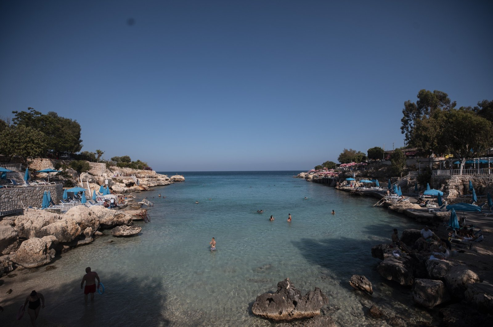 People enjoy a day in the sun at a beach in Mersin province, Turkey, June 21, 2020. (IHA Photo)