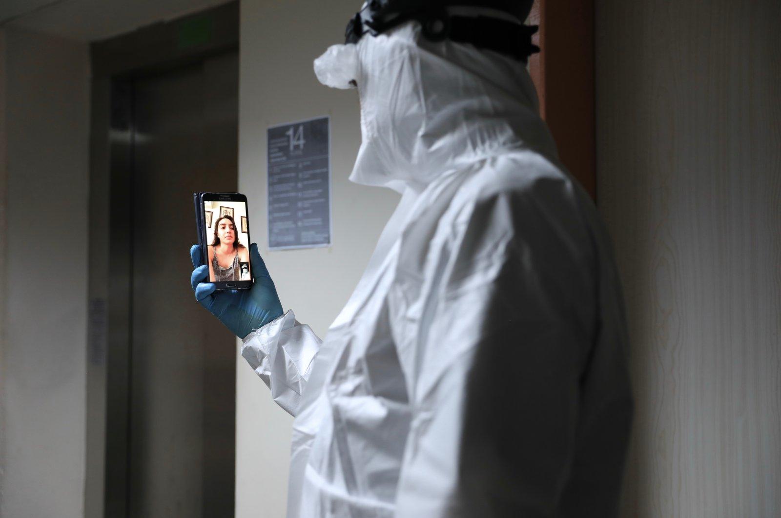 Doctor Mert Aydın talks to his daughter via videocall, in Izmir, Turkey, June 21, 2020. (AA Photo)