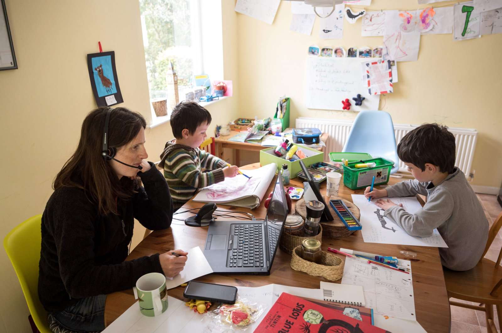Homeschooling typically adds to the mother's working day, not the father's. (AFP Photo)