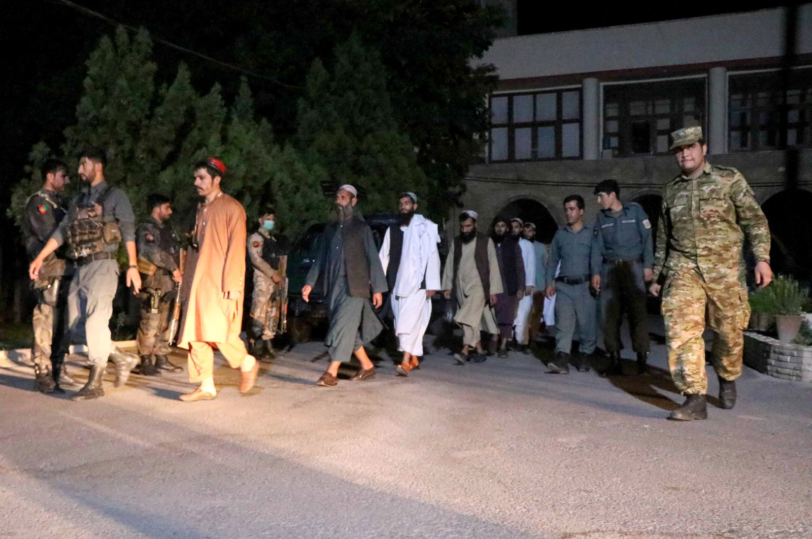 Taliban prisoners walk in line during their release from in Herat, Afghanistan, June 17, 2020. (EPA Photo)