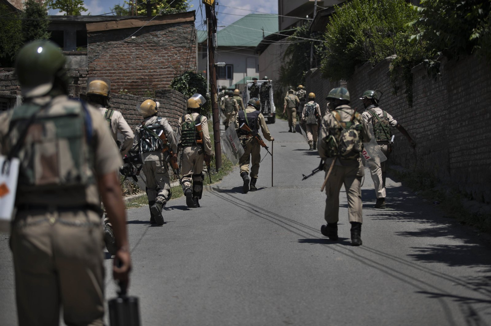 Indian soldiers return from the site of a gunbattle in Srinagar, Indian-controlled Kashmir, June 21, 2020. (AP Photo)
