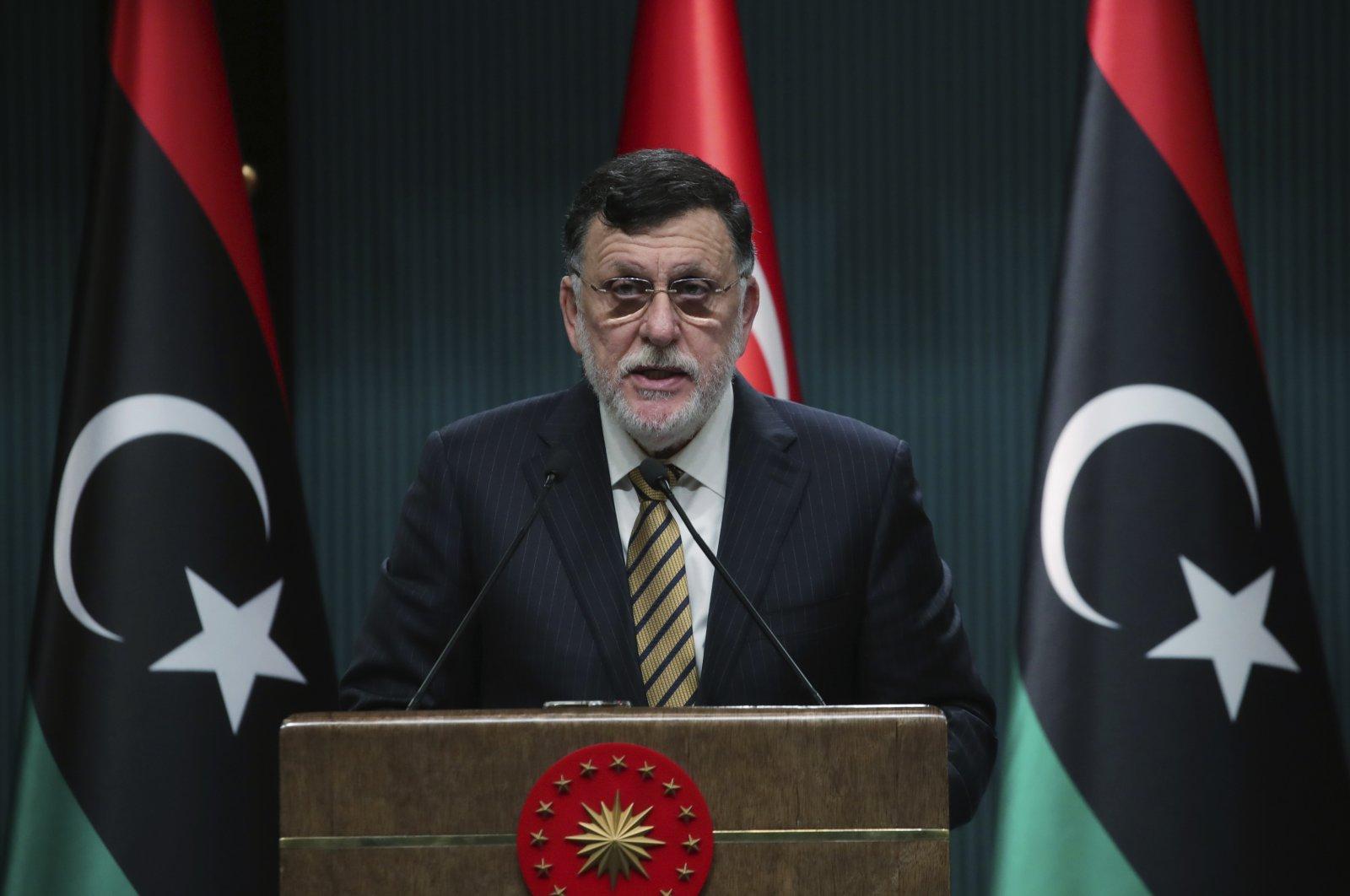 Fayez Sarraj, the head of Libya's internationally-recognized government, speaks at a joint news conference with Turkey's President Recep Tayyip Erdoğan, in Ankara, Turkey, June 4, 2020. (Turkish Presidency via AP)