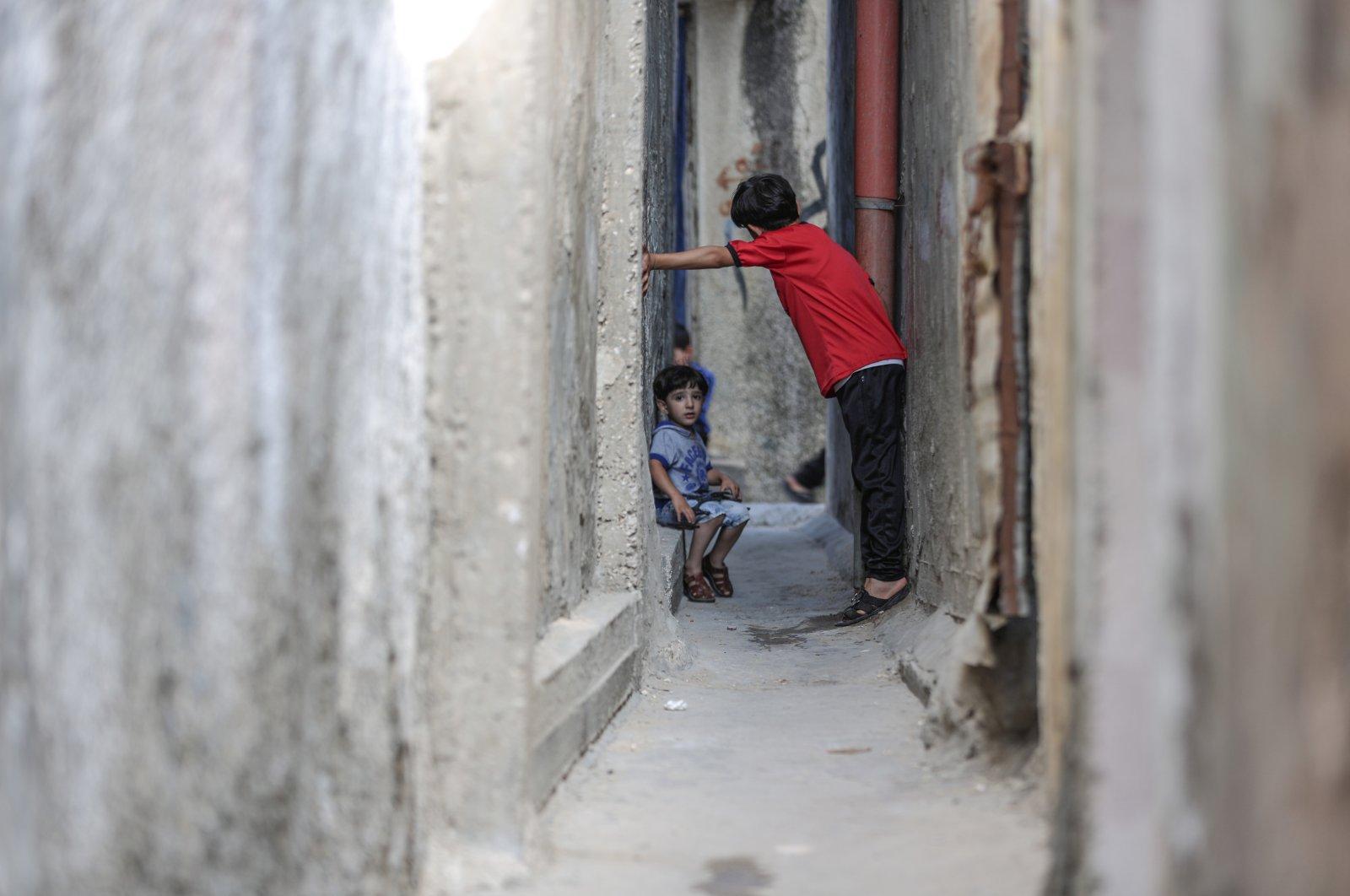 Two Palestinian children are seen in Jabalia refugee camp, Gaza Strip, Palestine, June 21, 2020. (AA Photo)