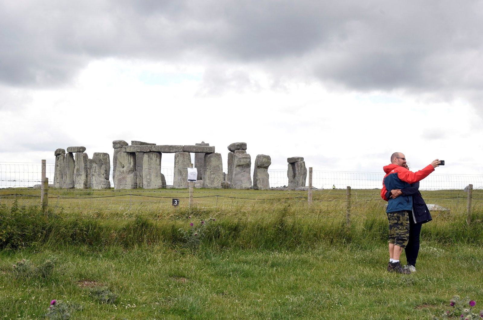 A couple takes a selfie while visiting Stonehenge near Amesbury, Britain, June 20, 2020. (Reuters Photo)