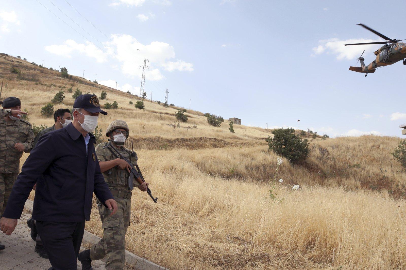 Turkish Defense Minister Hulusi Akar visits Turkish troops at the border with Iraq, in Hakkari province, Turkey, June 19, 2020. (AP Photo)