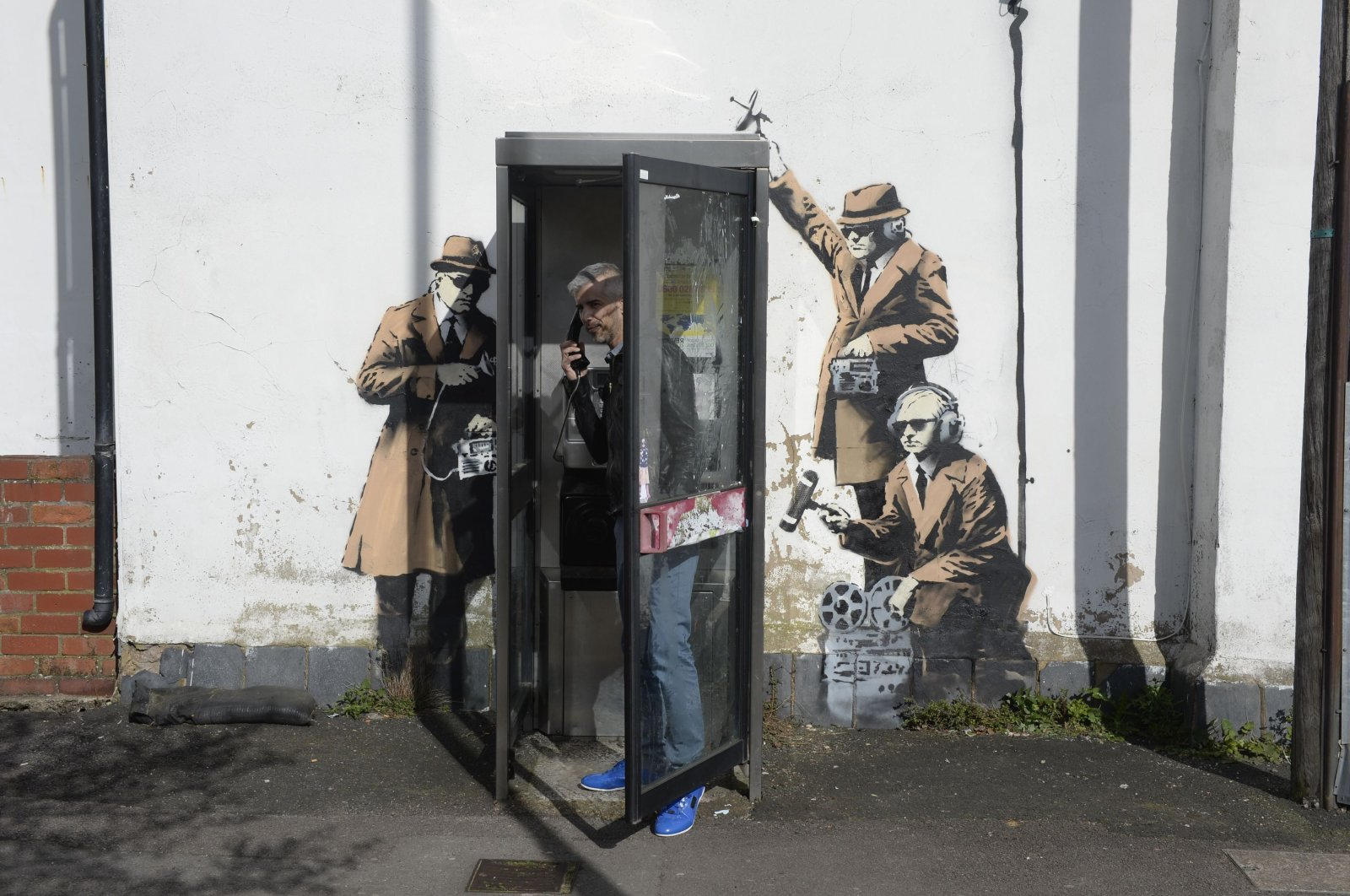 In this file photo, a new graffiti street art piece, suspected of being a Banksy, appears in Cheltenham, England, April 14, 2014. (AP Photo)