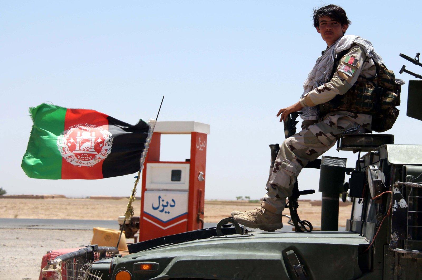 Afghan security forces patrol a highway in Helmand, Afghanistan, June 14, 2020. (EPA Photo)