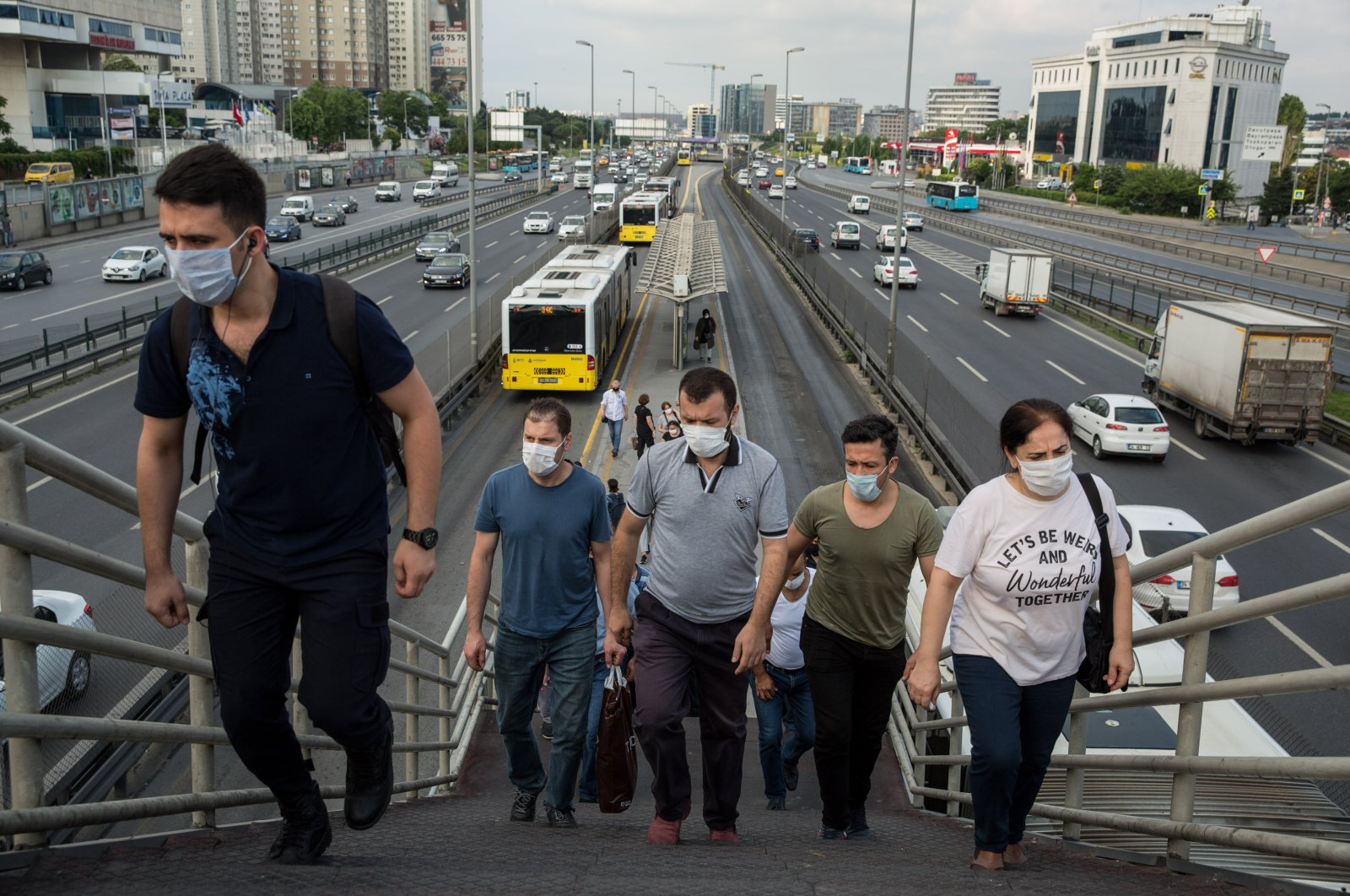People wearing masks leave a metrobus station, in Istanbul, Turkey, June 22, 2020. (DHA Photo)