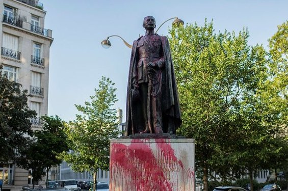 The statue of Hubert Lyautey, who served in Morocco, Algeria, Madagascar and Indochina when they were under French control, is daubed with red painting, Paris, June 22, 2020. (AP Photo)