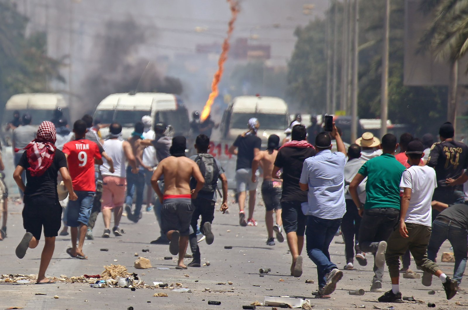 Tunisian protesters clash with security forces as they demand authorities make good on a 2017 promise to provide jobs in the gas and oil sector to thousands of unemployed, in the southern city of Tataouine, Tunisia, June 22, 2020. (AFP Photo)