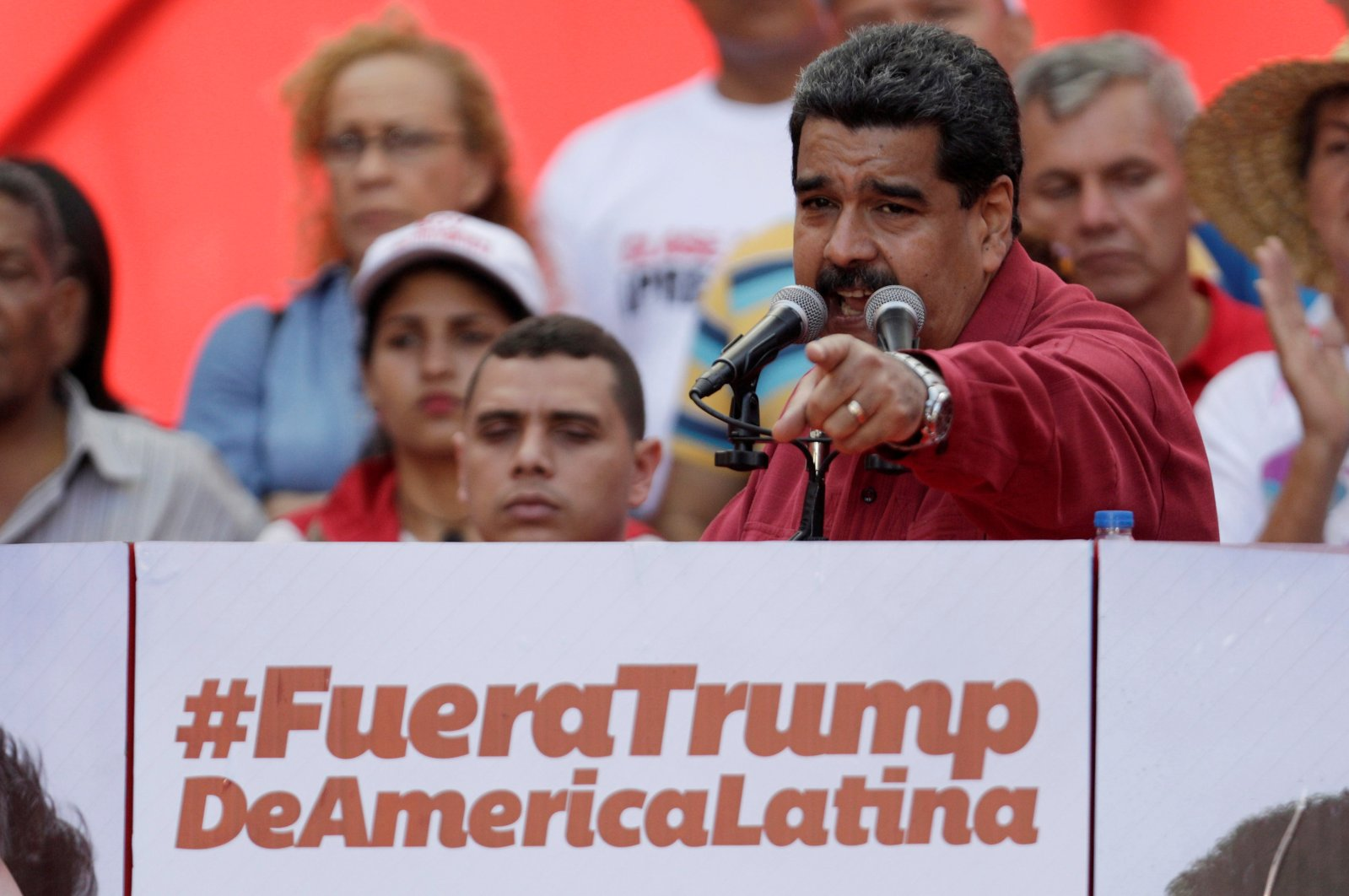 """Venezuela's President Nicolas Maduro gives a speech in front of a sign, which reads: """"Trump go away from Latin America,"""" at a rally against U.S. President Donald Trump in Caracas, Venezuela, Aug. 14, 2017. (Reuters Photo)"""