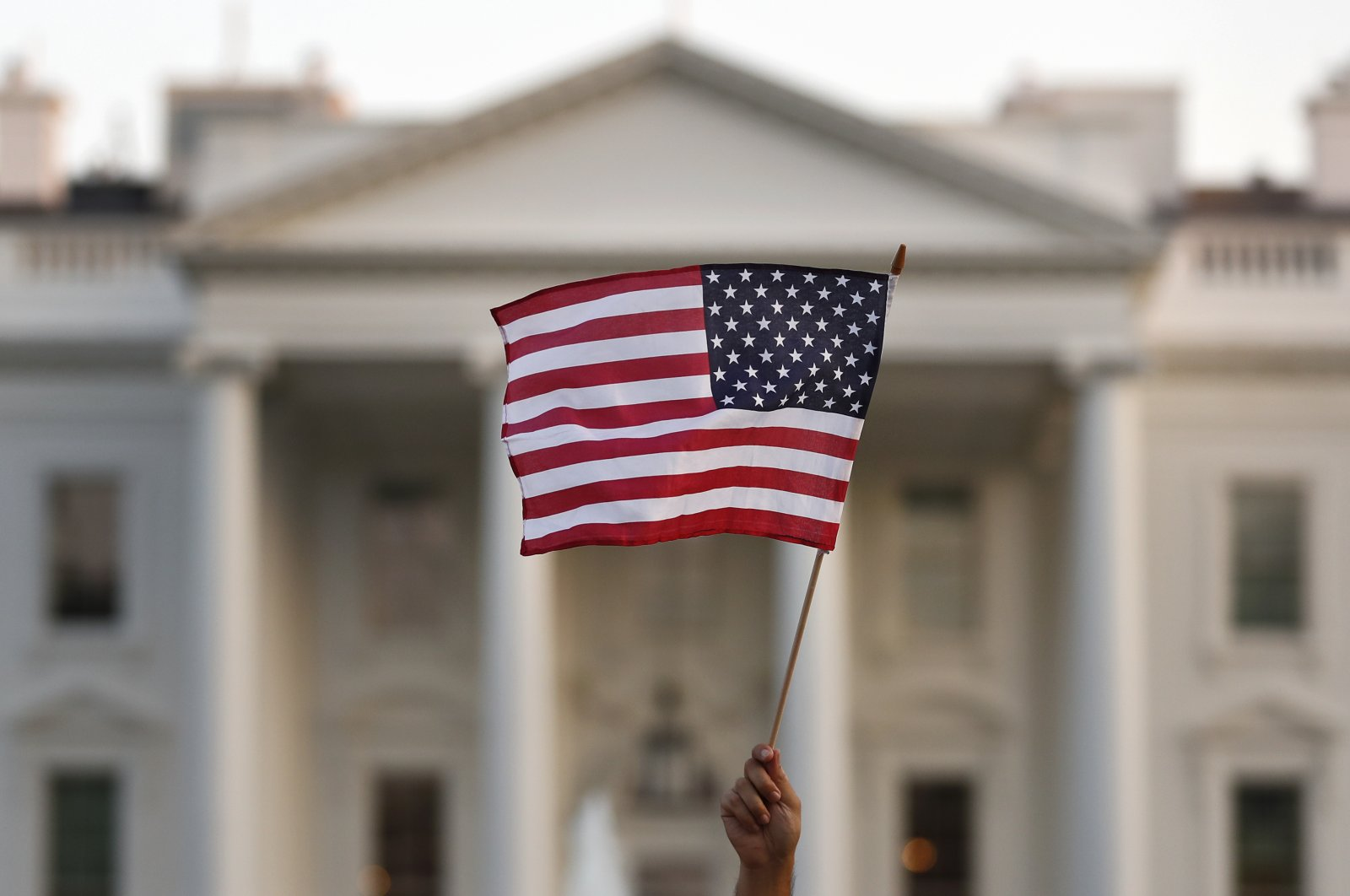 A flag is waved outside the White House, in Washington D.C., Sept. 5, 2017. (AP Photo)