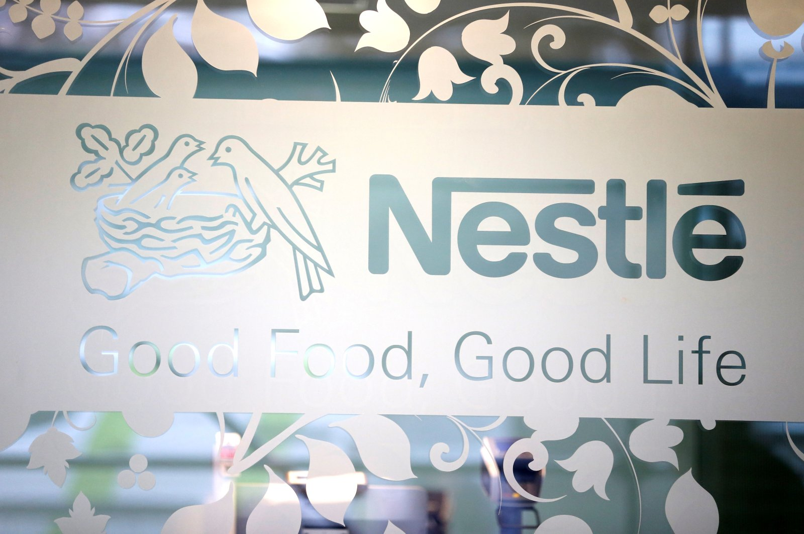 Nestle logo is pictured on the door of the supermarket of Nestle headquarters in Vevey, Switzerland, Feb. 13, 2020. (Reuters Photo)