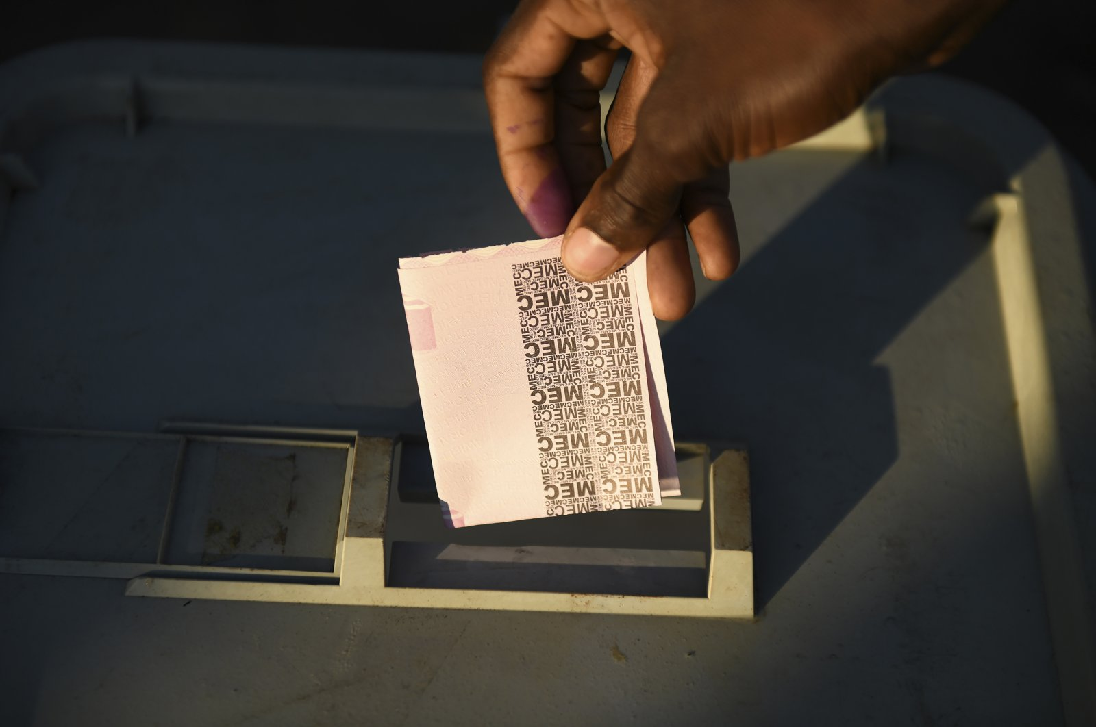 Residents queue to cast their votes in Blantyre, Malawi, June 23 2020. (AP Photo/Thoko Chikondi)