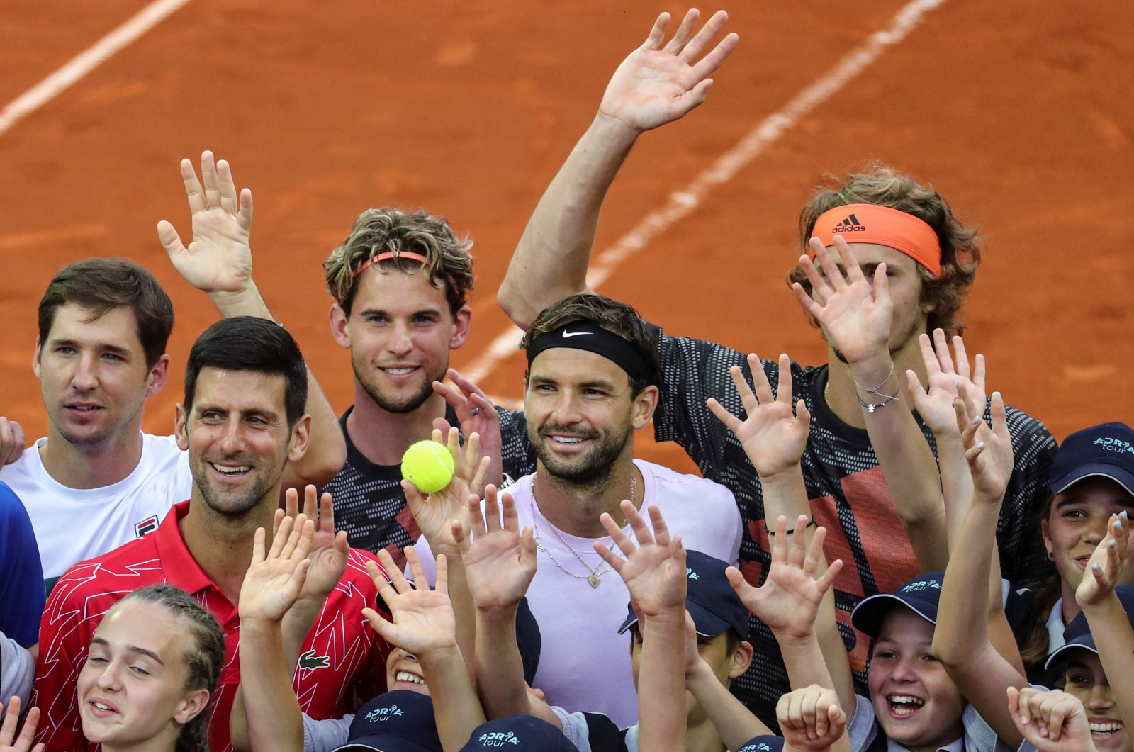 From left to right: Dusan Lajovic, Novak Djokovic, Dominic Thiem, Grigor Dimitrov and Alexander Zverev pose with ballkids during Adria Tour in Belgrade, Serbia, June 12, 2020. (Reuters Photo)