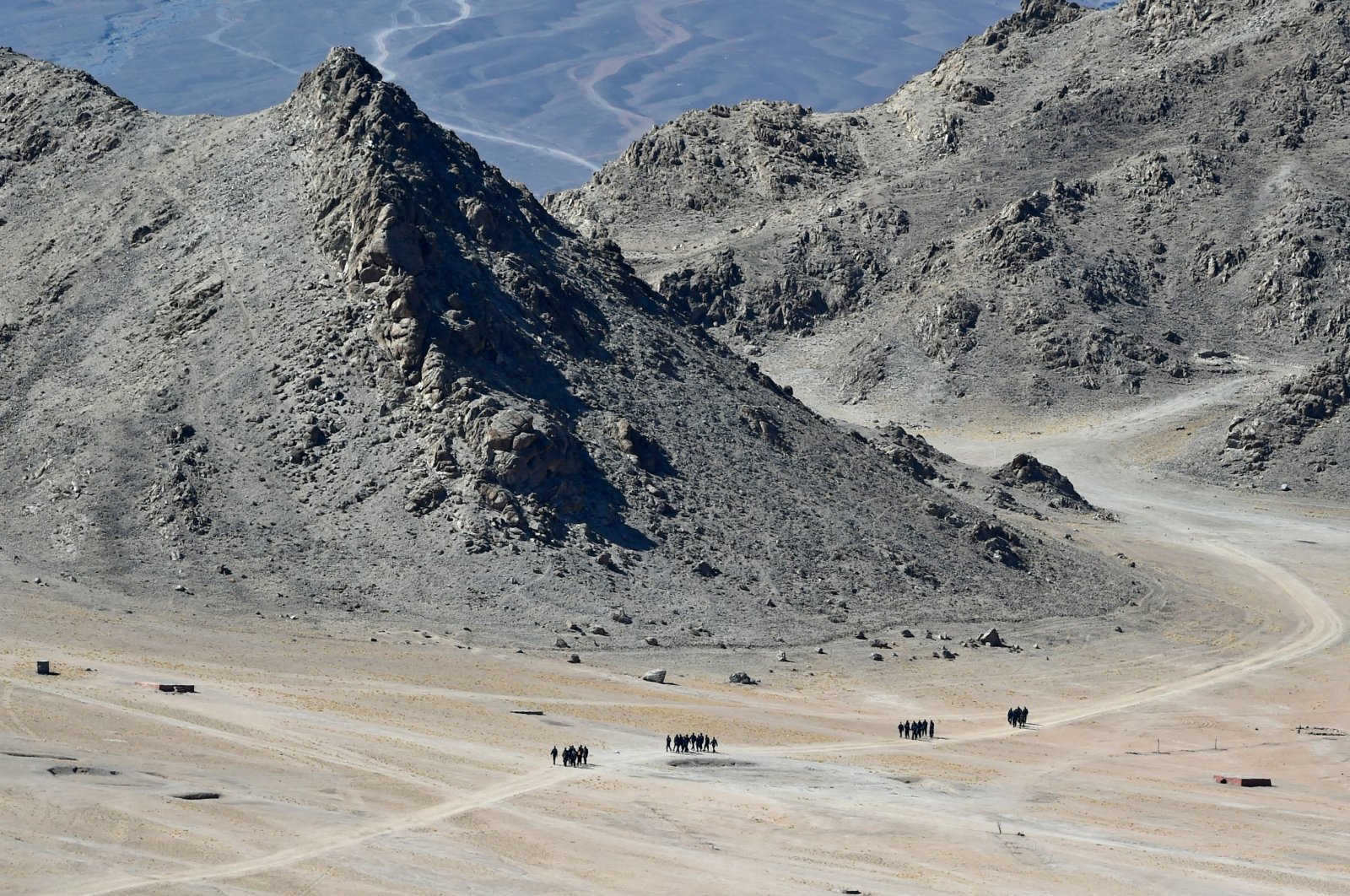 Indian soldiers walk at the foothills of a mountain range near Leh on June 23, 2020. (AFP Photo)