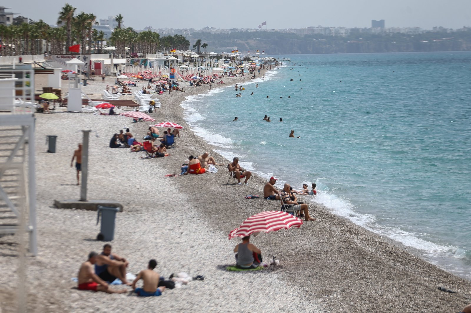 Tourists enjoy the sun at a beach in Antalya, a popular holiday resort in southern Turkey, June 23, 2020. (AA Photo)