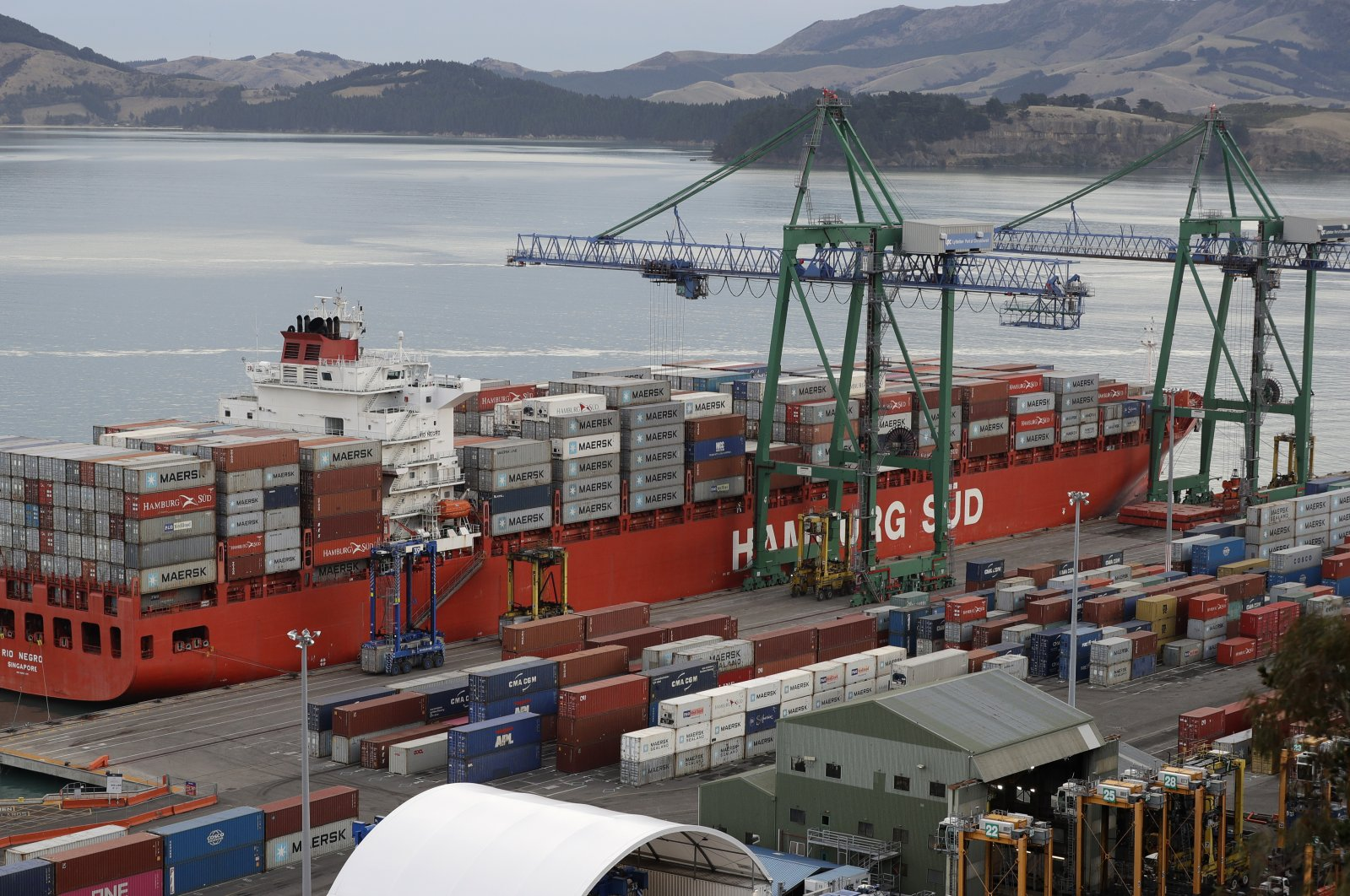 Containers are loaded onto a ship for export at Lyttelton Port near Christchurch, New Zealand, June 3, 2020. (AP Photo)