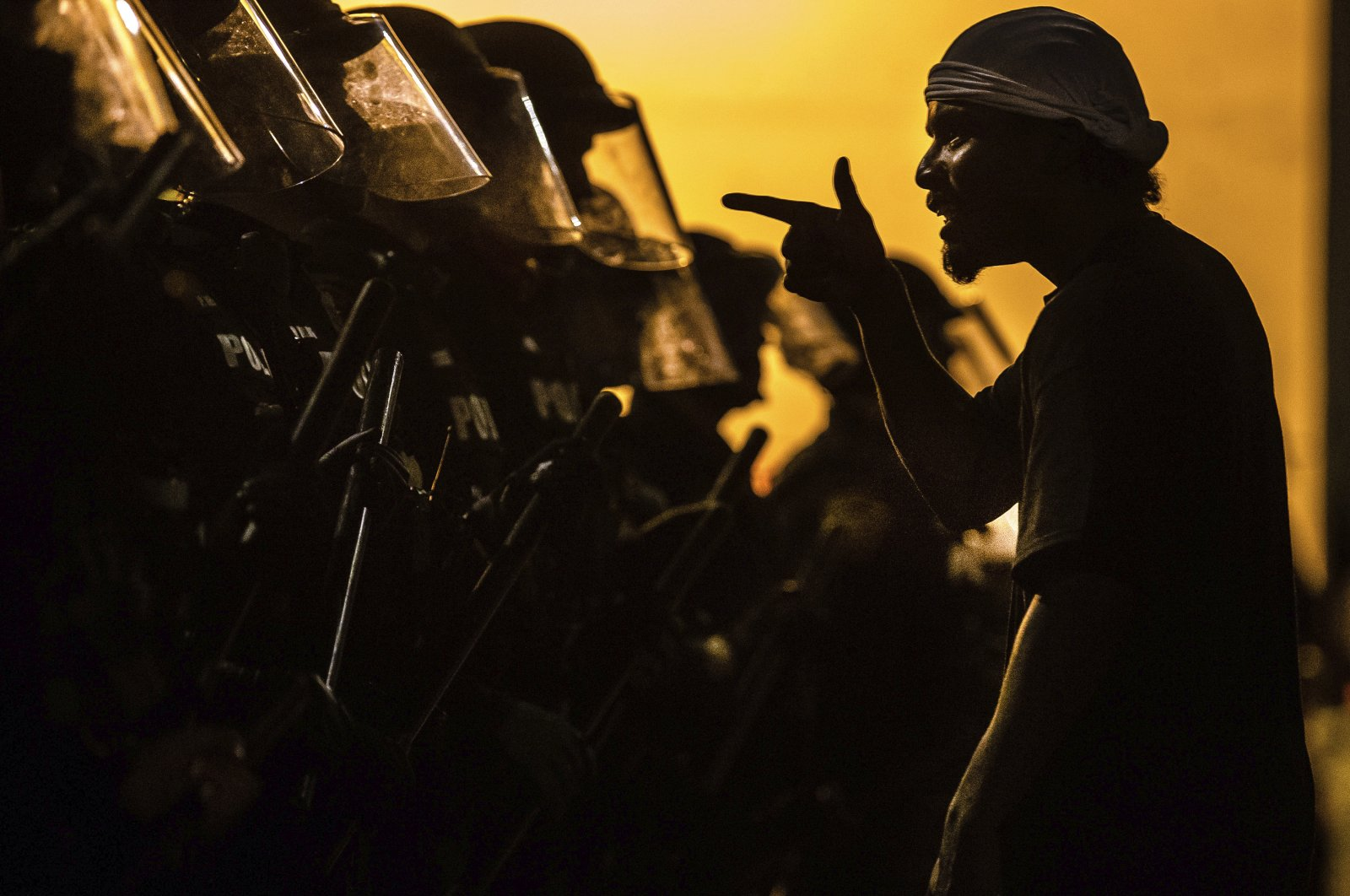 A protester addresses a line of Tucson Police Officers in riot gear in Tucson, Ariz, May 30, 2020. (AP Photo)