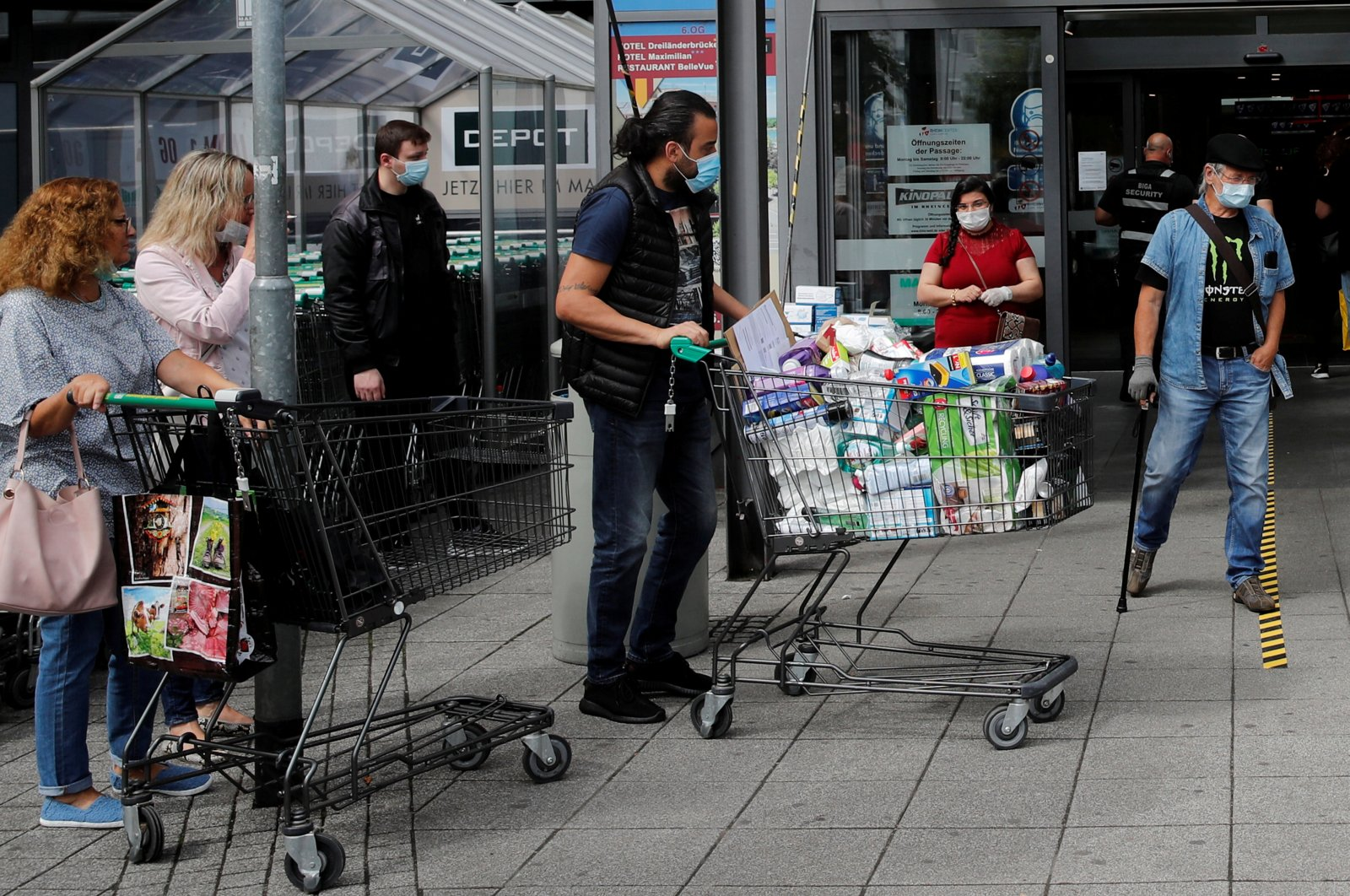 People are seen in front of the entrance of the Rhein Center shopping mall after the reopening of the borders, amid the coronavirus outbreak, in Weil am Rhein, Germany, June 15, 2020. (Reuters Photo)