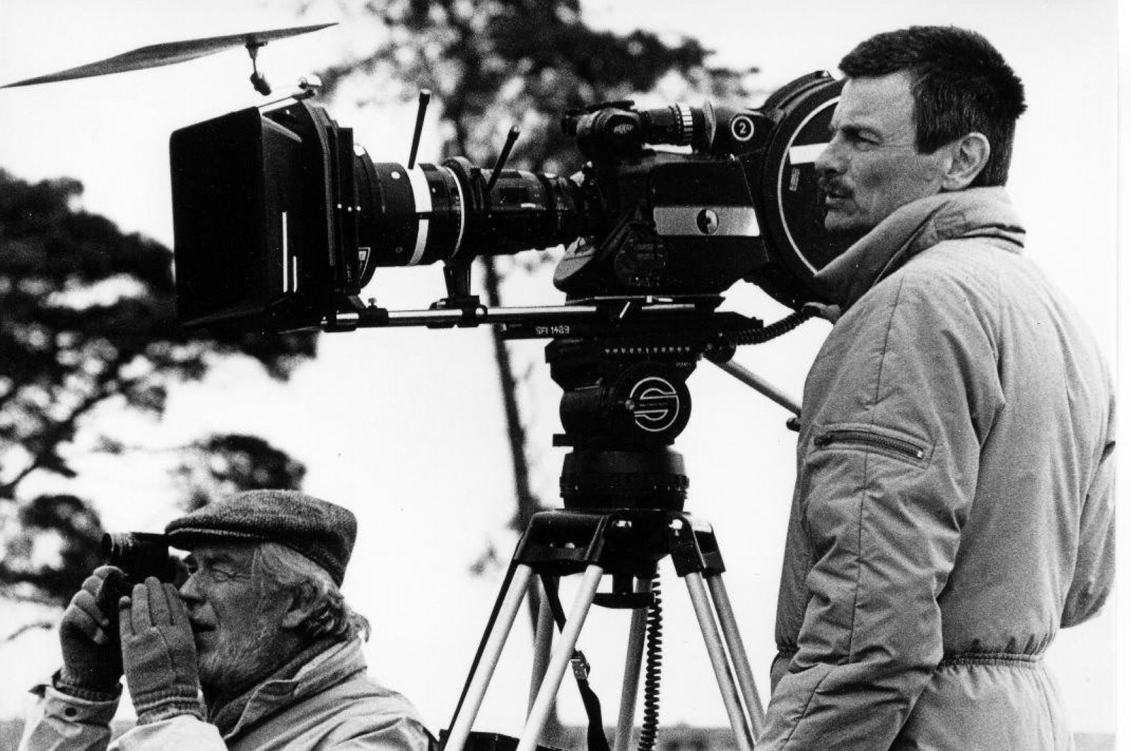 An undated photo showing Tarkovsky behind a camera during a filming. (Courtesy of Pera Museum)