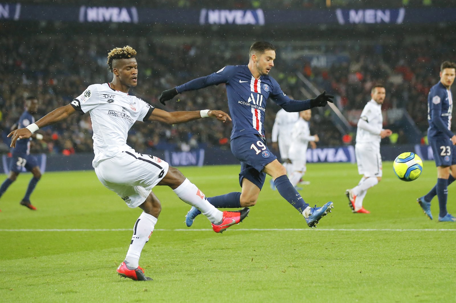Dijon's Didier Ndong (L) kicks the ball ahead of PSG's Pablo Sarabia during a French Ligue 1 match in Paris, France, Feb. 29, 2020. (AP Photo)